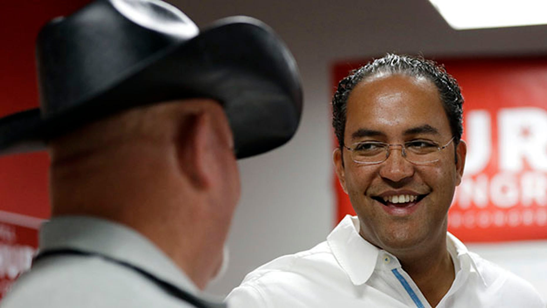 First-term Republican Rep. Will Hurd with a supporter at a campaign office, in San Antonio.