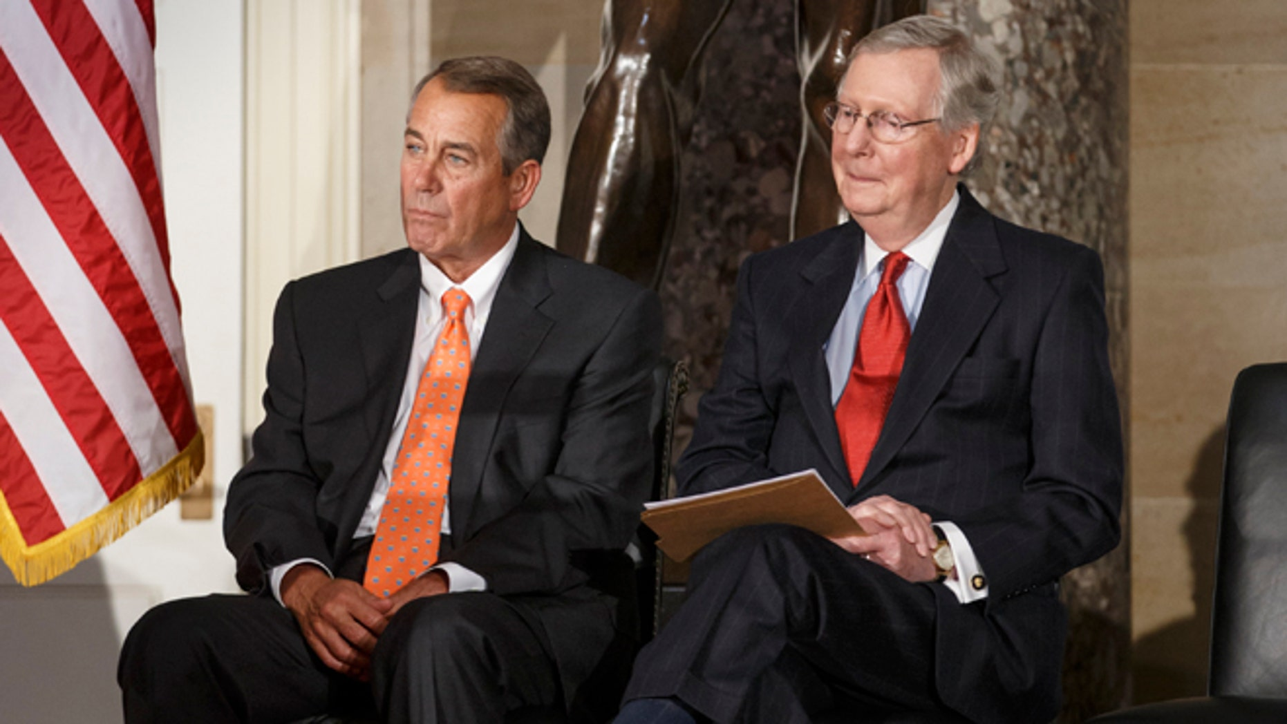 """House Speaker John Boehner of Ohio, and Senate Majority Leader Mitch McConnell of Ky. attend a statue unveiling ceremony honoring former Arizona Sen. Barry Goldwater, Wednesday, Feb. 11, 2015, on Capitol Hill in Washington. Boehner and McConnell are at a standstill over provisions attached to a Homeland Security spending bill aimed at blocking President Barack Obama's executive actions on immigration. McConnell declared a Senate stalemate Tuesday and called on the House to make the next move to avoid an agency shutdown. House Republicans said they had no intention of doing so and today, Wednesday, Feb. 11, 2015, Speaker Boehner declared that Senate Democrats should """"get off their ass"""" and pass a bill to fund the Homeland Security Department and restrict President Barack Obama's executive moves on immigration.  (AP Photo/J. Scott Applewhite)"""