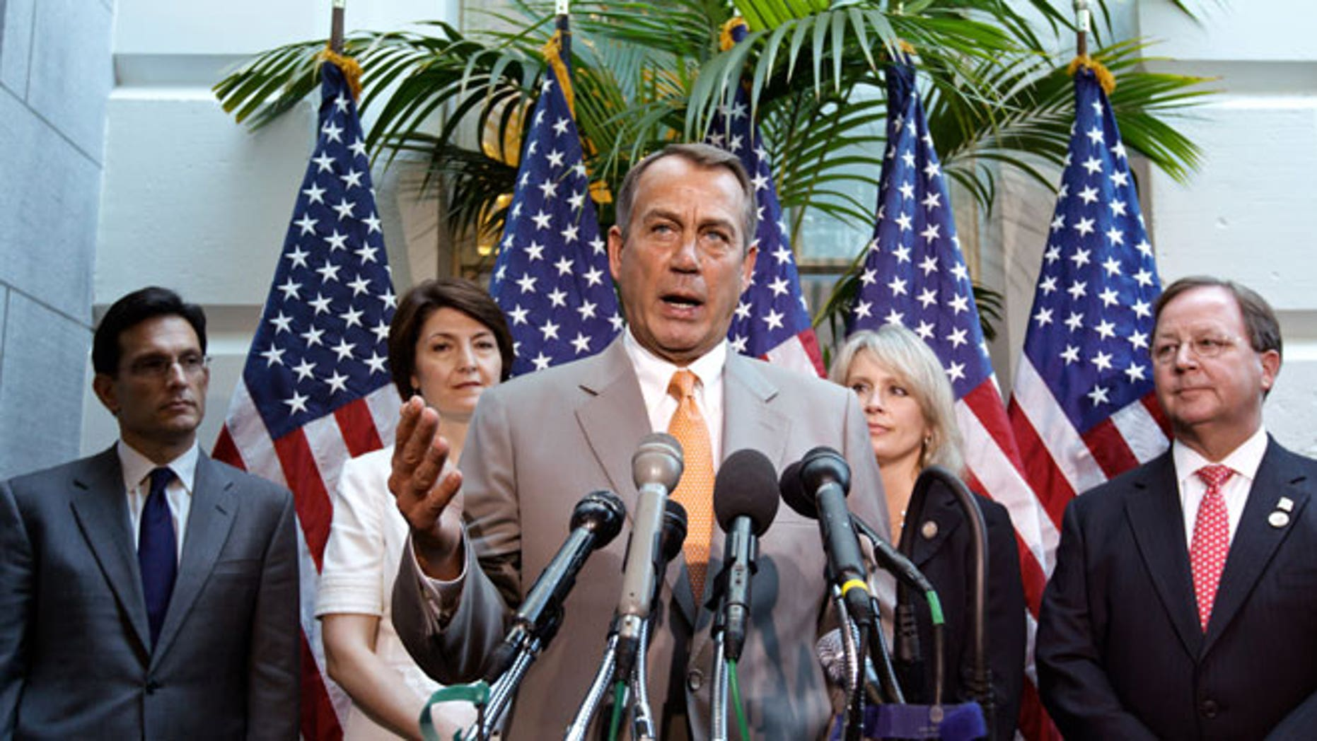 June 27, 2012: House Speaker John Boehner of Ohio, center, joined by other House GOP leaders, gestures during a news conference on Capitol Hill in Washington.