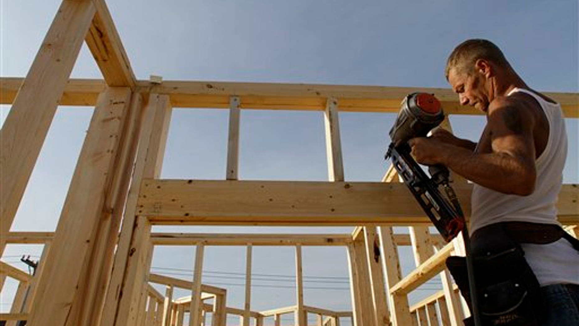 In this photo taken Sept, 13, 2010, construction worker Randy Shreves begins building a new residential home in Springfield, Ill. (AP Photo/Seth Perlman)