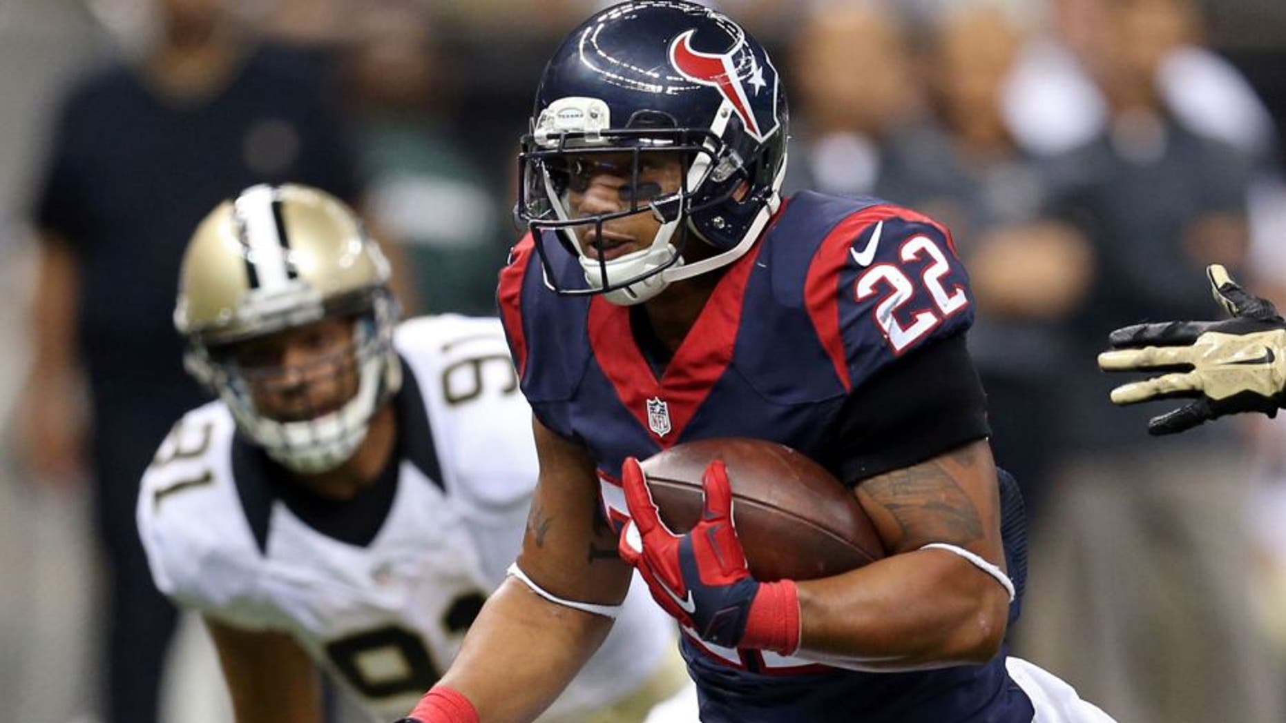 Aug 30, 2015; New Orleans, LA, USA; Houston Texans running back Chris Polk (22) makes a run in the second quarter of their game against the New Orleans Saints at the Mercedes-Benz Superdome. Mandatory Credit: Chuck Cook-USA TODAY Sports