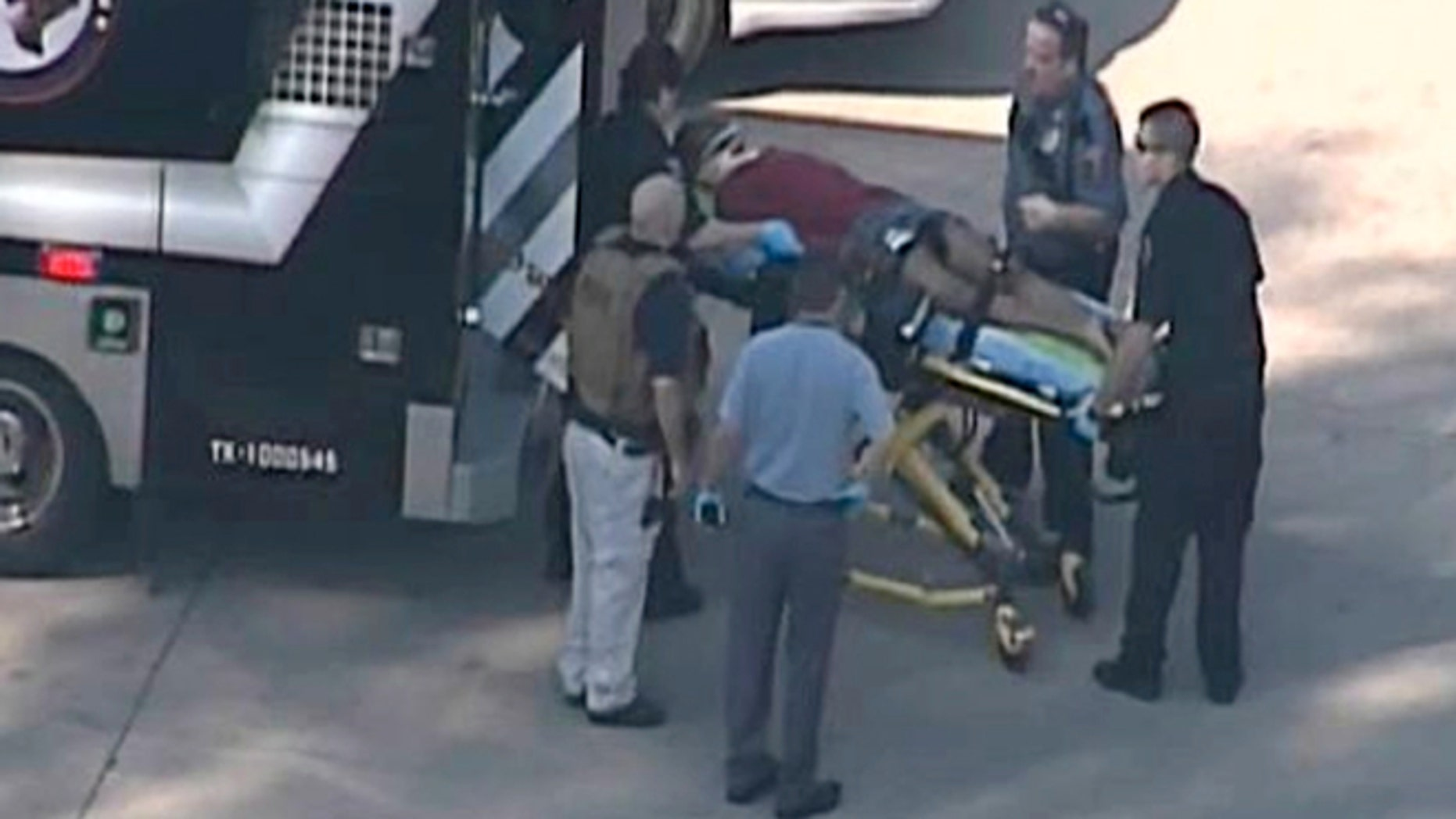 Jan. 22, 2013: In this frame grab provided by KPRC Houston, an unidentified person is transported by emergency personnel at Lone Star College Tuesday in Houston, where law enforcement officials say the community college is on lockdown amid reports of a shooter on campus.