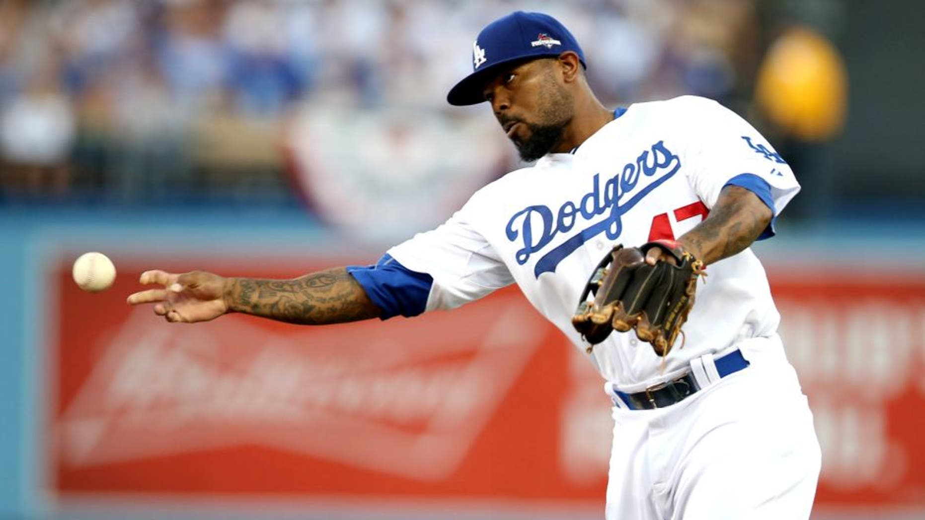 LOS ANGELES, CA - OCTOBER 15: Howie Kendrick #47 of the Los Angeles Dodgers throws to first base during Game 5 of the NLDS against the New York Mets at Dodgers Stadium on Thursday, October 15, 2015 in Los Angeles, California. (Photo by Rob Leiter/MLB Photos via Getty Images)