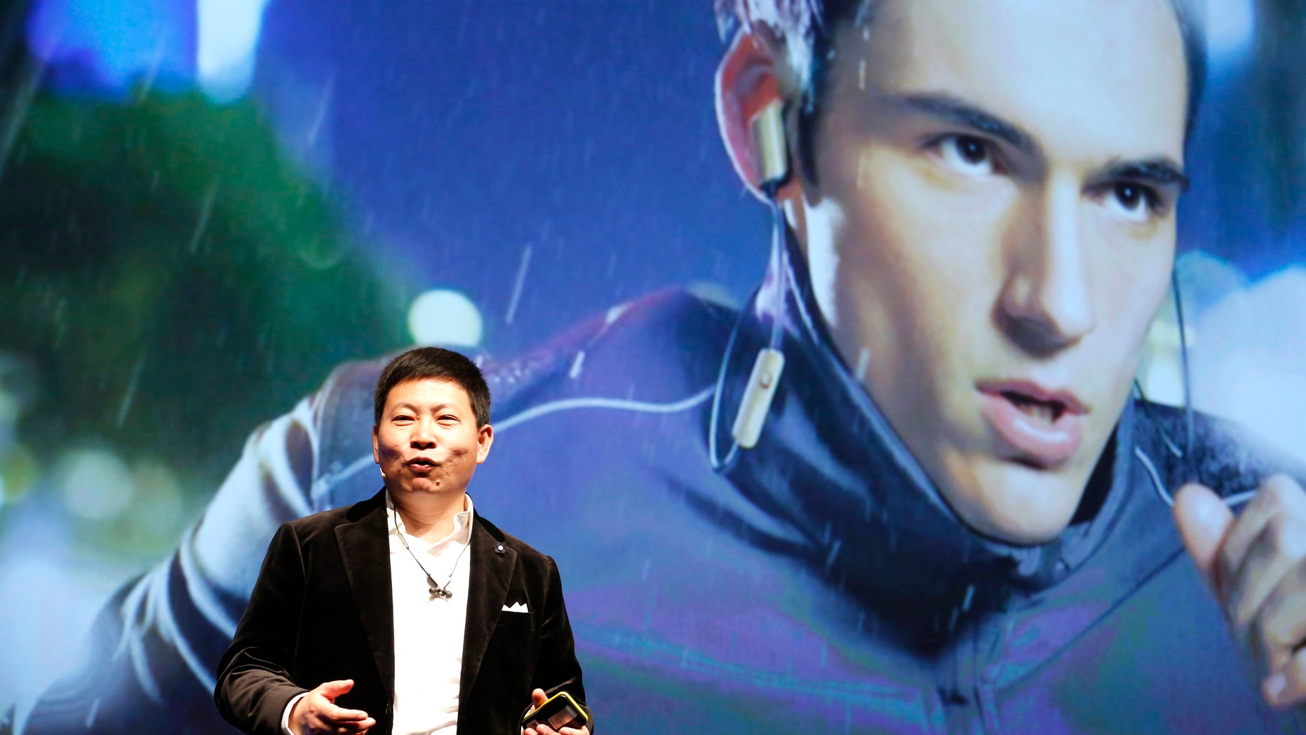 Huawei Chief Executive Richard Yu presents the TalkBand N1 during a news conference in Barcelona March 1, 2015.
