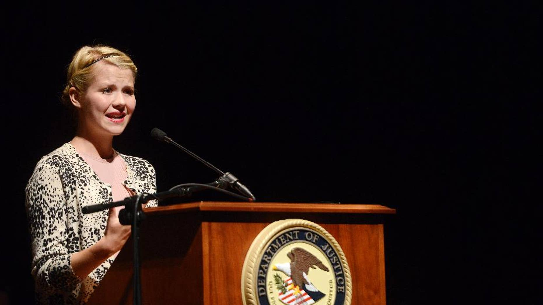 Elizabeth Smart-Gilmour speaks on overcoming adversity and her story of being kidnapped when she was 14, during a conference on violent crime and human trafficking held in Sioux Falls, S.D., Wednesday, Aug 13, 2014. (AP Photo/Argus Leader, Elisha Page)