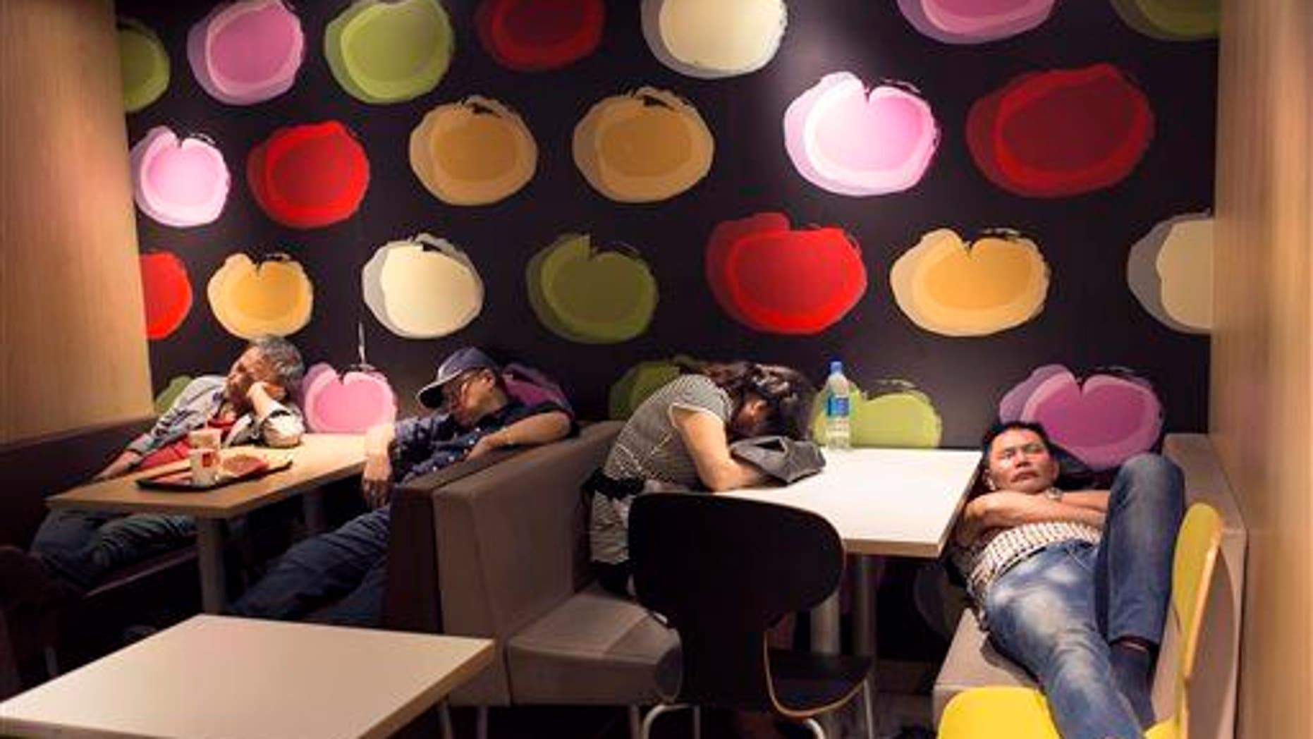 A group of people sleep in a 24-hour McDonald���s in Hong Kong. A new study found humans are more efficient sleepers than our primate ancestors.