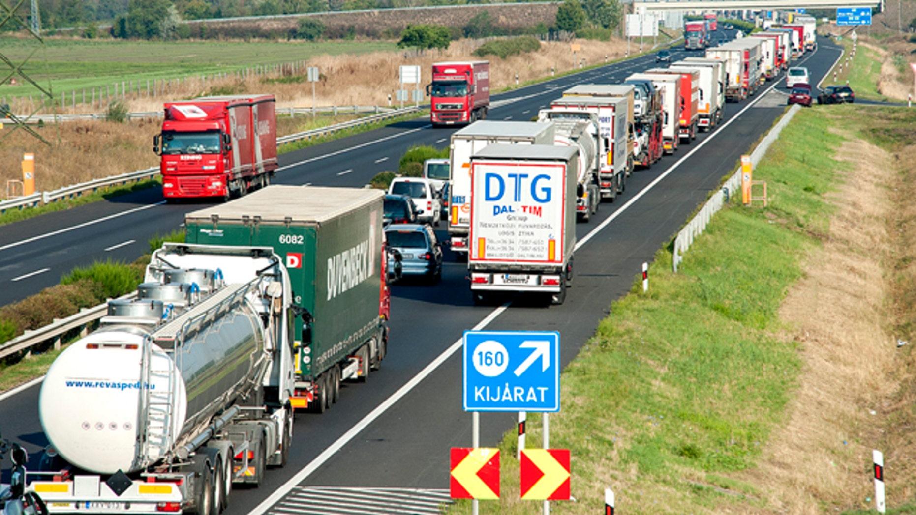 Aug. 31, 2015: A long queue of vehicles  waits  on the M1 motorway near the border between Hungary and Austria near Mosonmagyarovar, 158 km northwest from Budapest, Hungary. (Csaba Krizsan/MTI via AP)