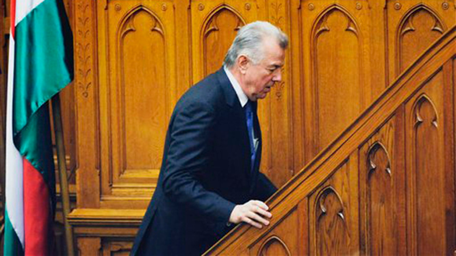 April 2, 2012: Hungarian President Pal Schmitt is seen on his way to the podium prior to his announcement of his resignation during the plenary session of the Parliament in Budapest, Hungary.
