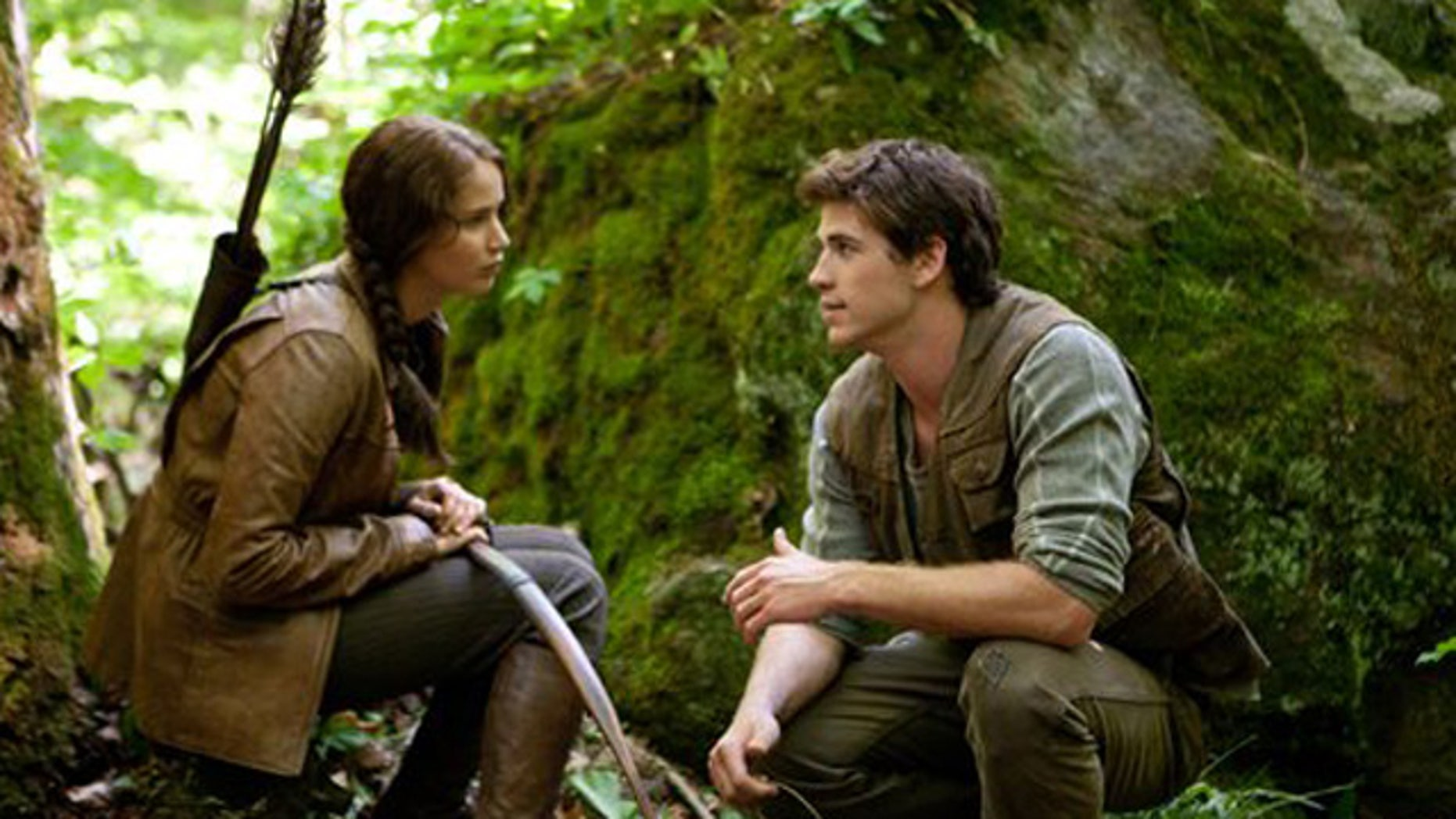 In this image released by Lionsgate, Jennifer Lawrence portrays Katniss Everdeen, left, and Liam Hemsworth portrays Gale Hawthorne in a scene from 'The Hunger Games.'