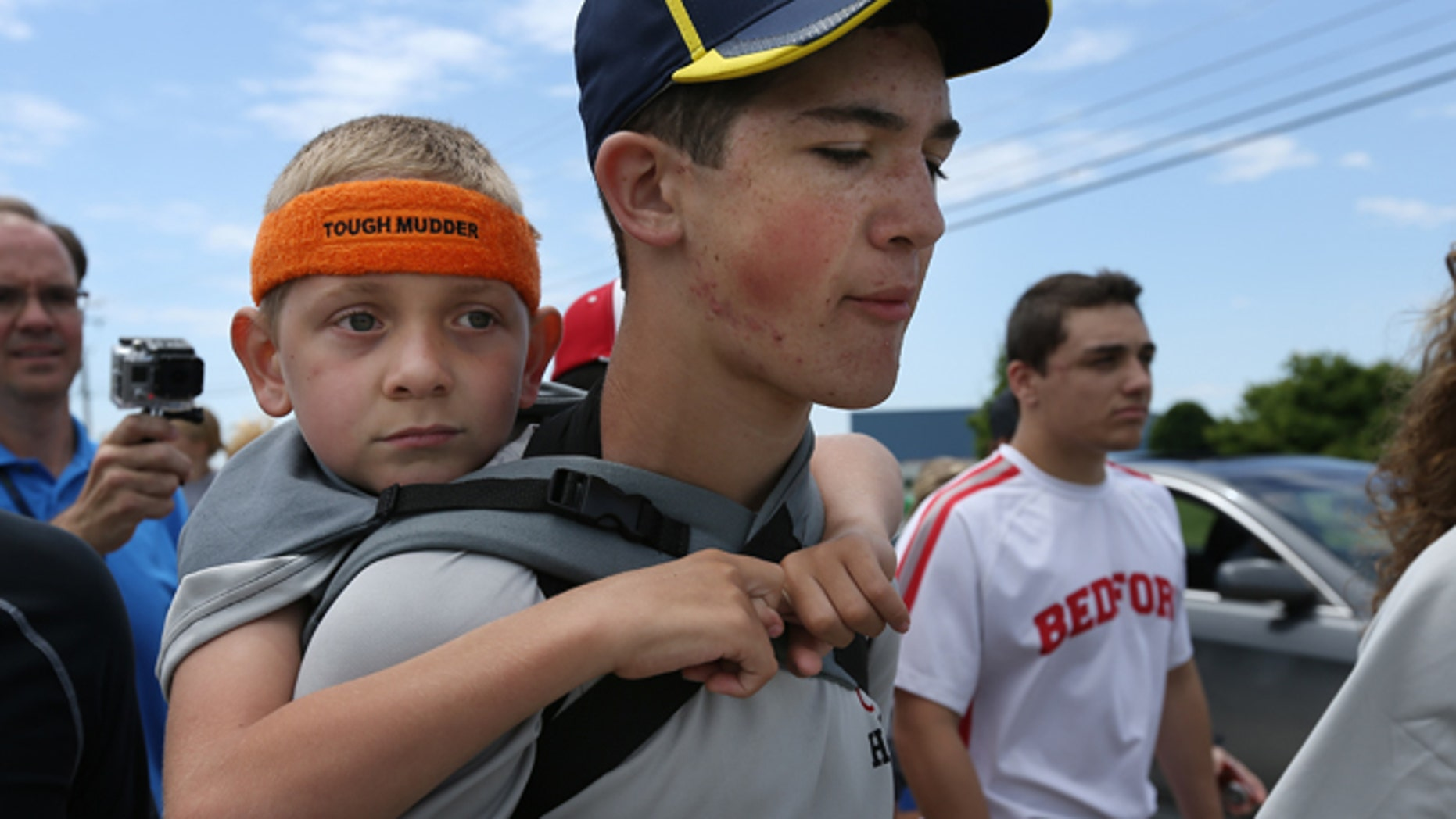 June 8, 2014:  Braden Gandee, 7, rides on his brother Hunter's, 14, shoulders as they close in on the final miles to the University of Michigan Bahna Wrestler Center. Hunter carried Braden, who has cerebral palsy, 40 miles from Bedford, Mich. to Ann Arbor, Mich.