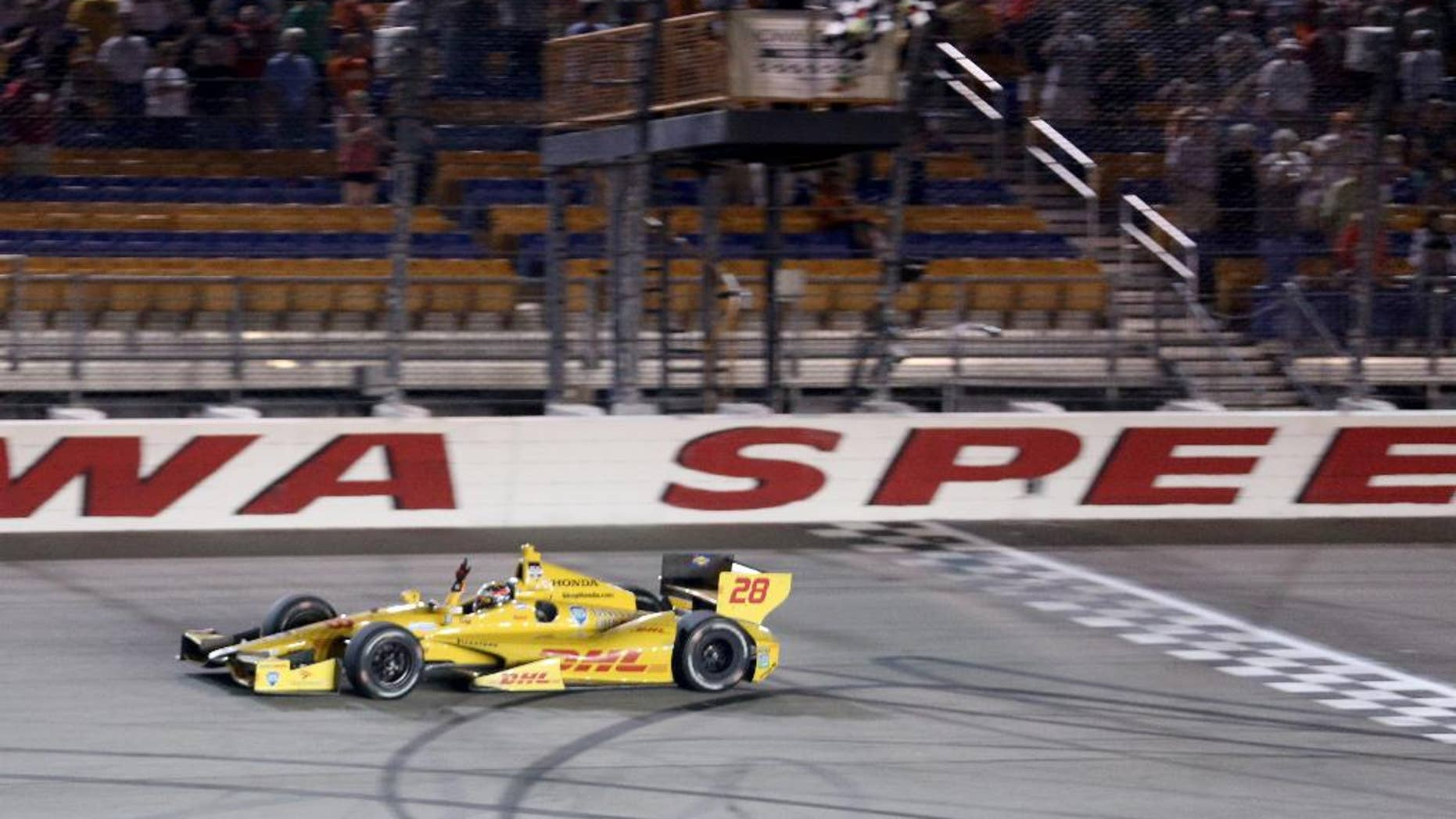 FILE - In this July 12, 2014, file photo, Ryan Hunter-Reay crosses the finish line to win the Indy Car series event in Newton, Iowa. Hunter-Reay is hoping that a return to the site of his last win will jumpstart a disappointing season.  (AP Photo/Justin Hayworth, File)