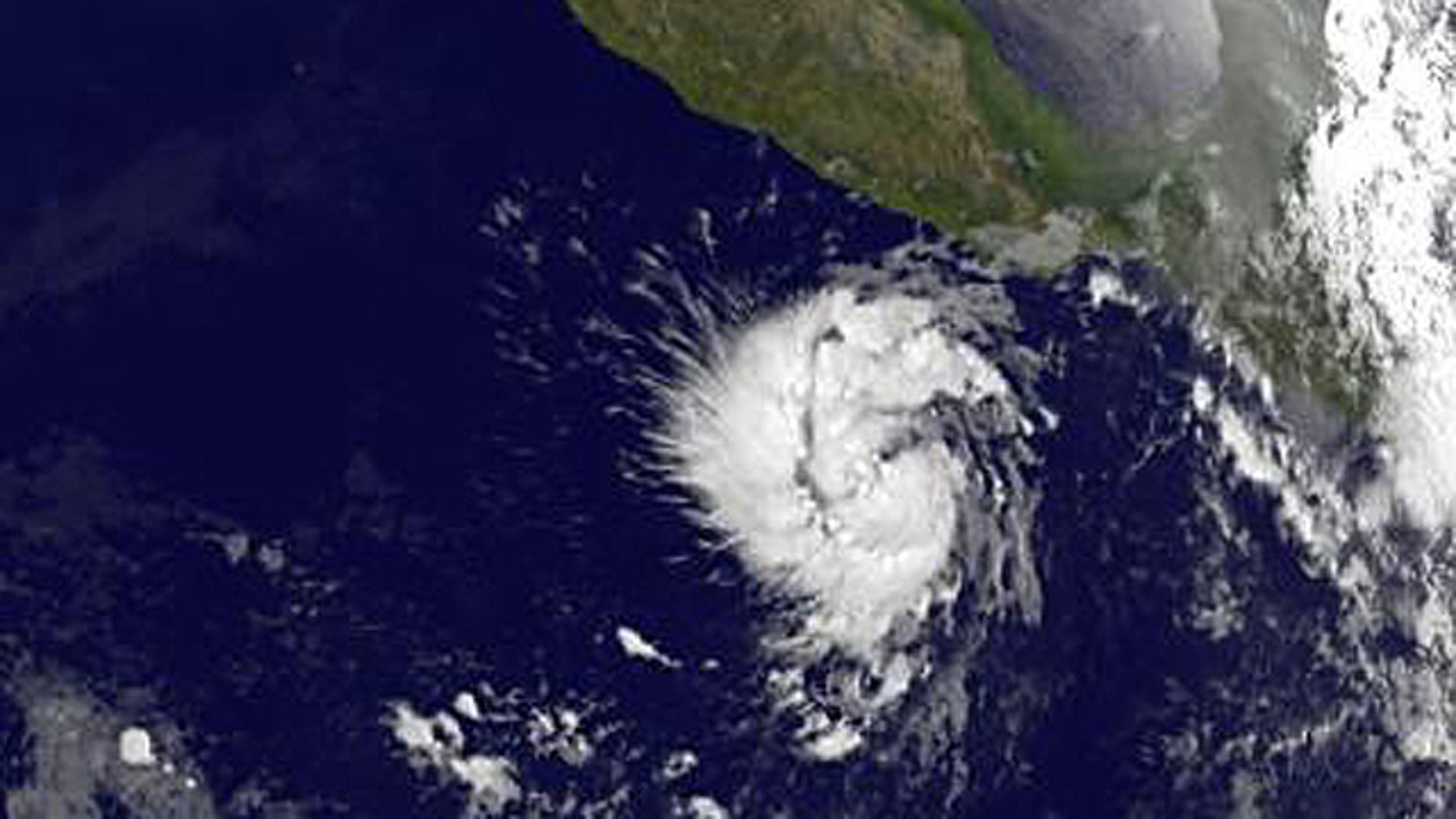 This infrared image of Tropical Storm Adrian was taken from the GOES-11 satellite on June 8 at 12:00 UTC (8:00 a.m. EDT) and shows a compact, rounded storm off the western Mexico coast. The image reveals that Adrian has some higher, stronger thunderstorms in the center that are casting shadows on lower clouds around them.