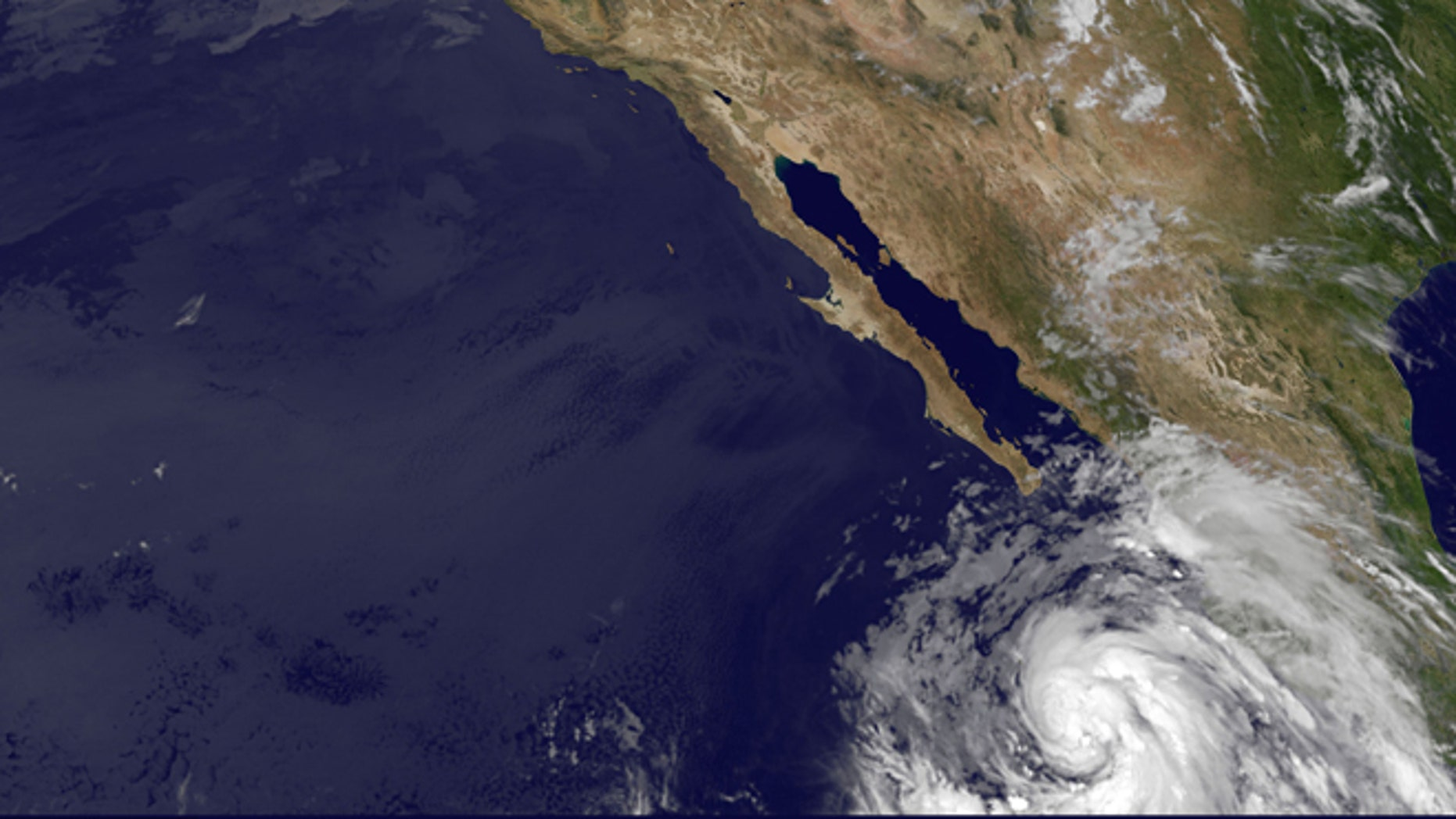 This image provided by NOAA shows tropical storm Cosme taken at 5:00 a.m. EDT Tuesday June 25, 2013. The storm's maximum sustained winds early Tuesday are near 65 mph (100 kph) with additional strengthening expected. Cosme is likely to become a hurricane later in the day as it swirls in the Pacific off Mexico's coast. It is not expected to make landfall.(AP Photo/NOAA)