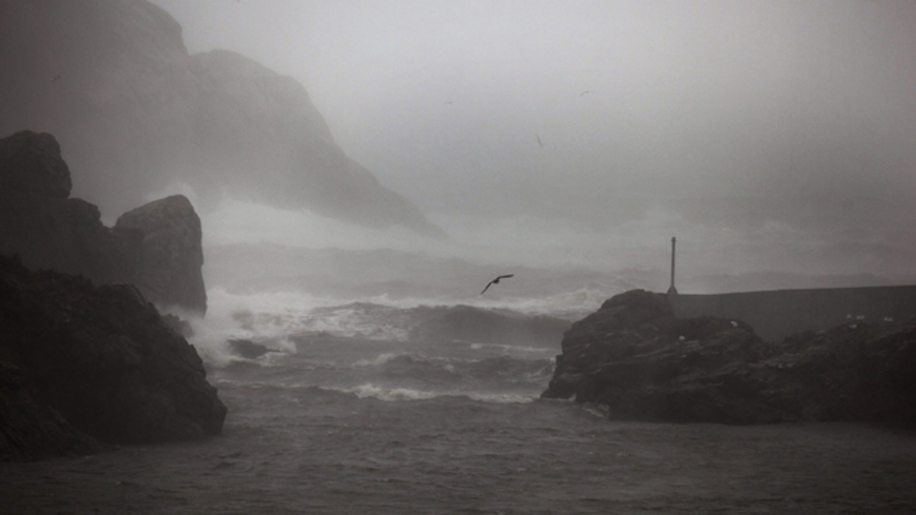 September 21: Large waves crash at Quidi Vidi Gut, an historic fishing community within St. John's, Canada as Hurricane Igor hit. Hurricane Igor caused widespread damage across an eastern swath of Newfoundland on Tuesday as heavy rains flooded communities, washed out roads and stranded some residents in their homes. (AP)