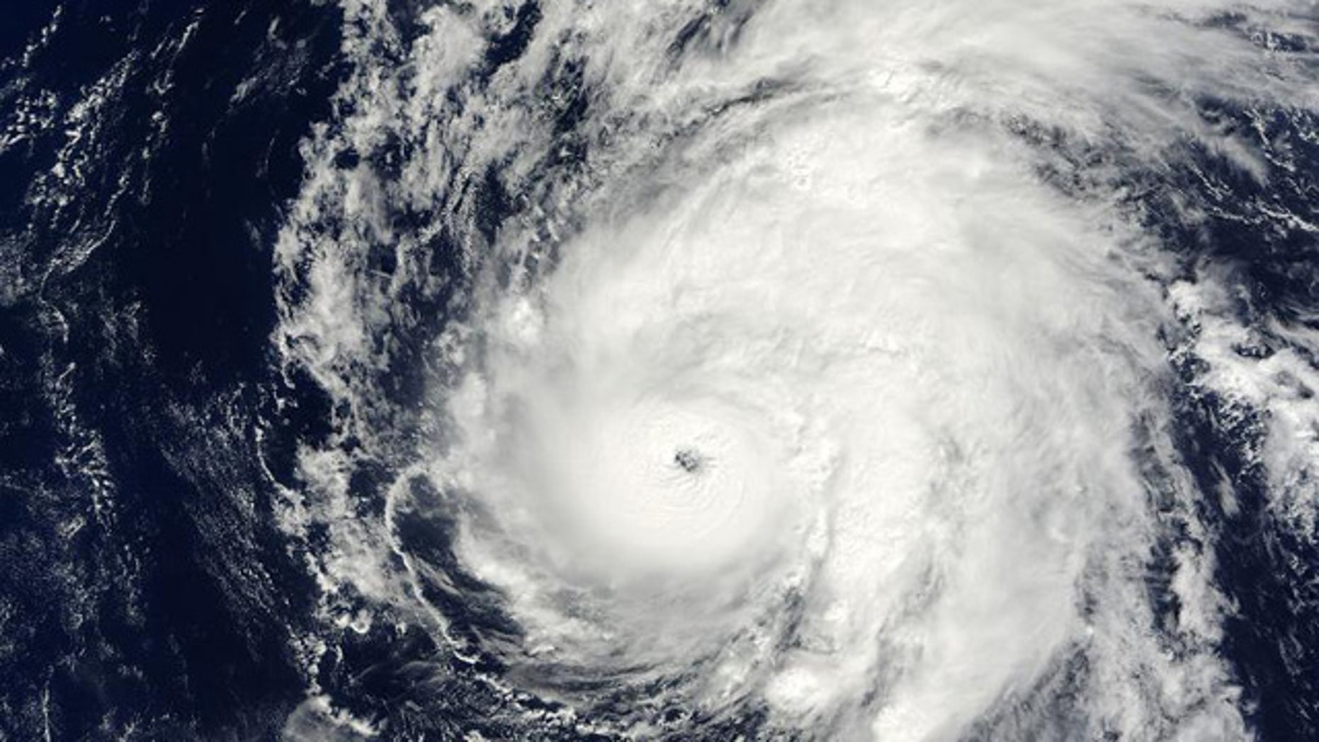 Hurricane Neki swirls through the oceans west of Hawaii.