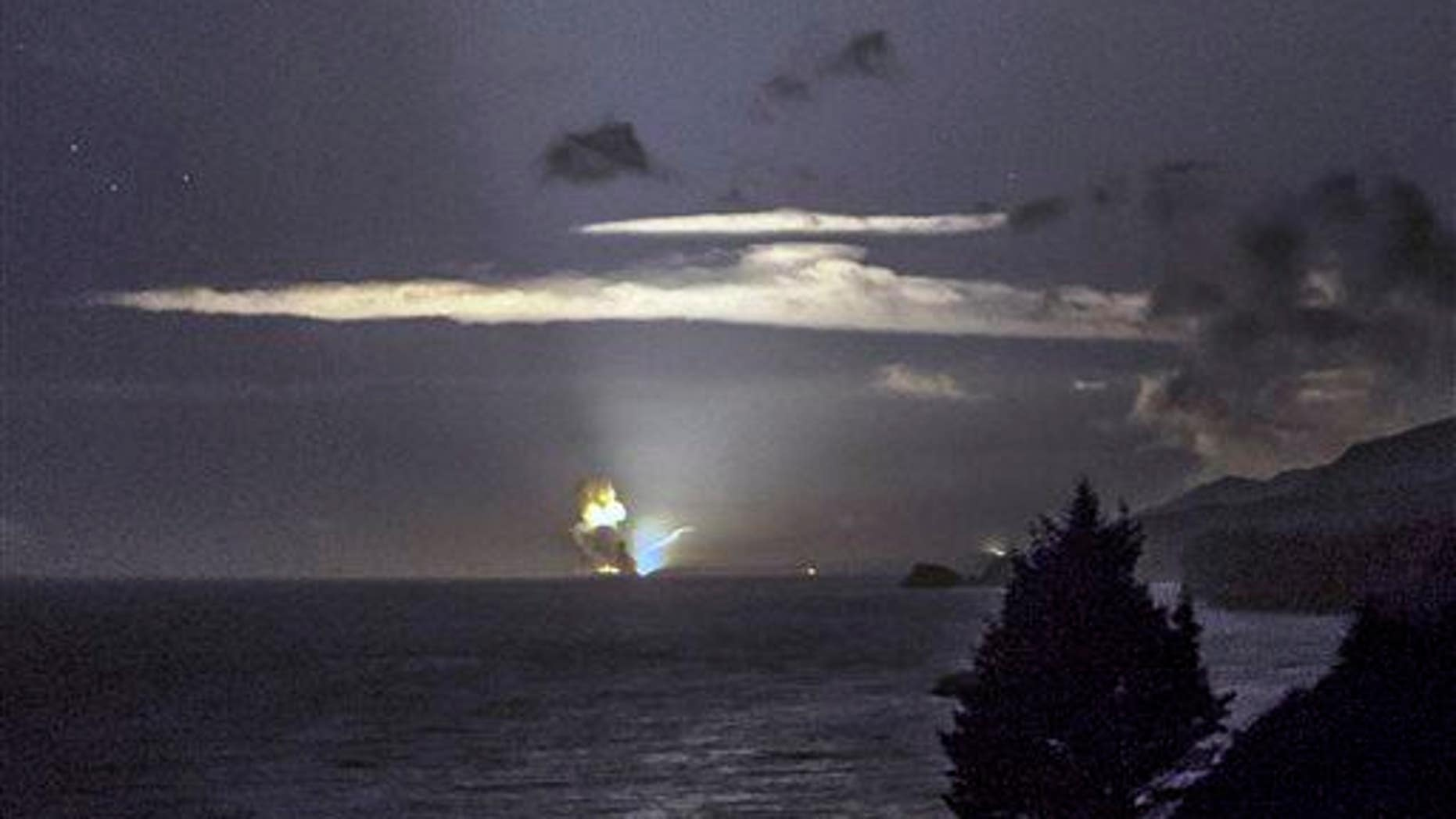 This Monday, Aug. 25, 2014, photo provided by Scott Wight shows the horizon from Cape Greville in Chiniak, Alaska, after authorities destroyed the weapon.
