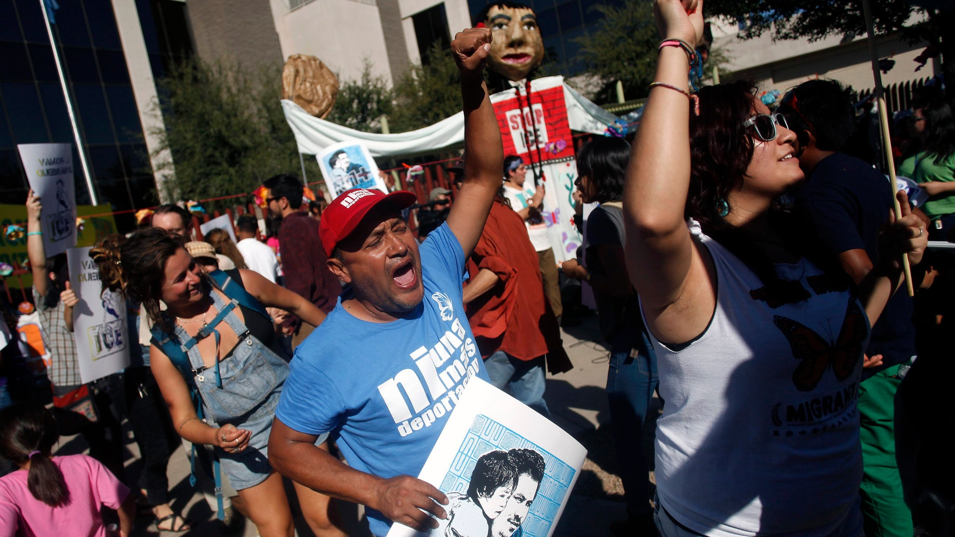 People protest against Immigration and Customs Enforcement at their headquarters in Phoenix, Arizona October 14, 2013.