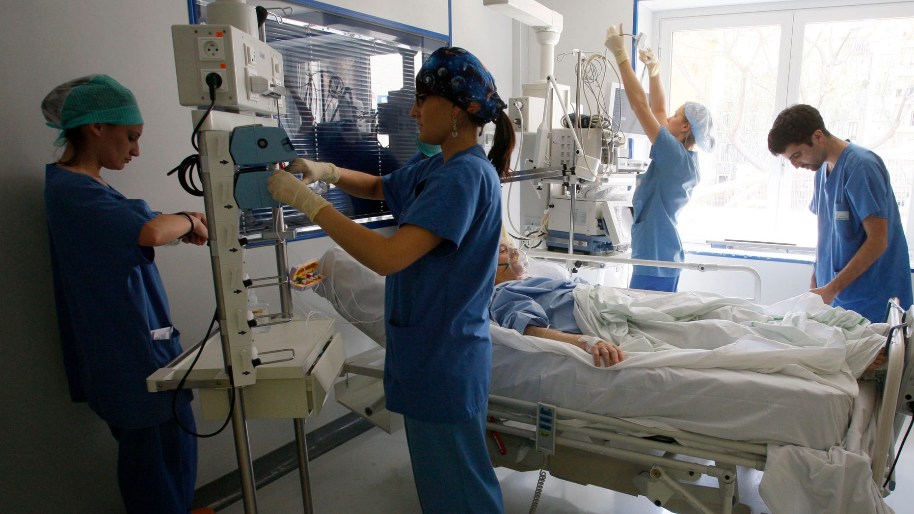 Nurses check a patient in the intensive care unit.
