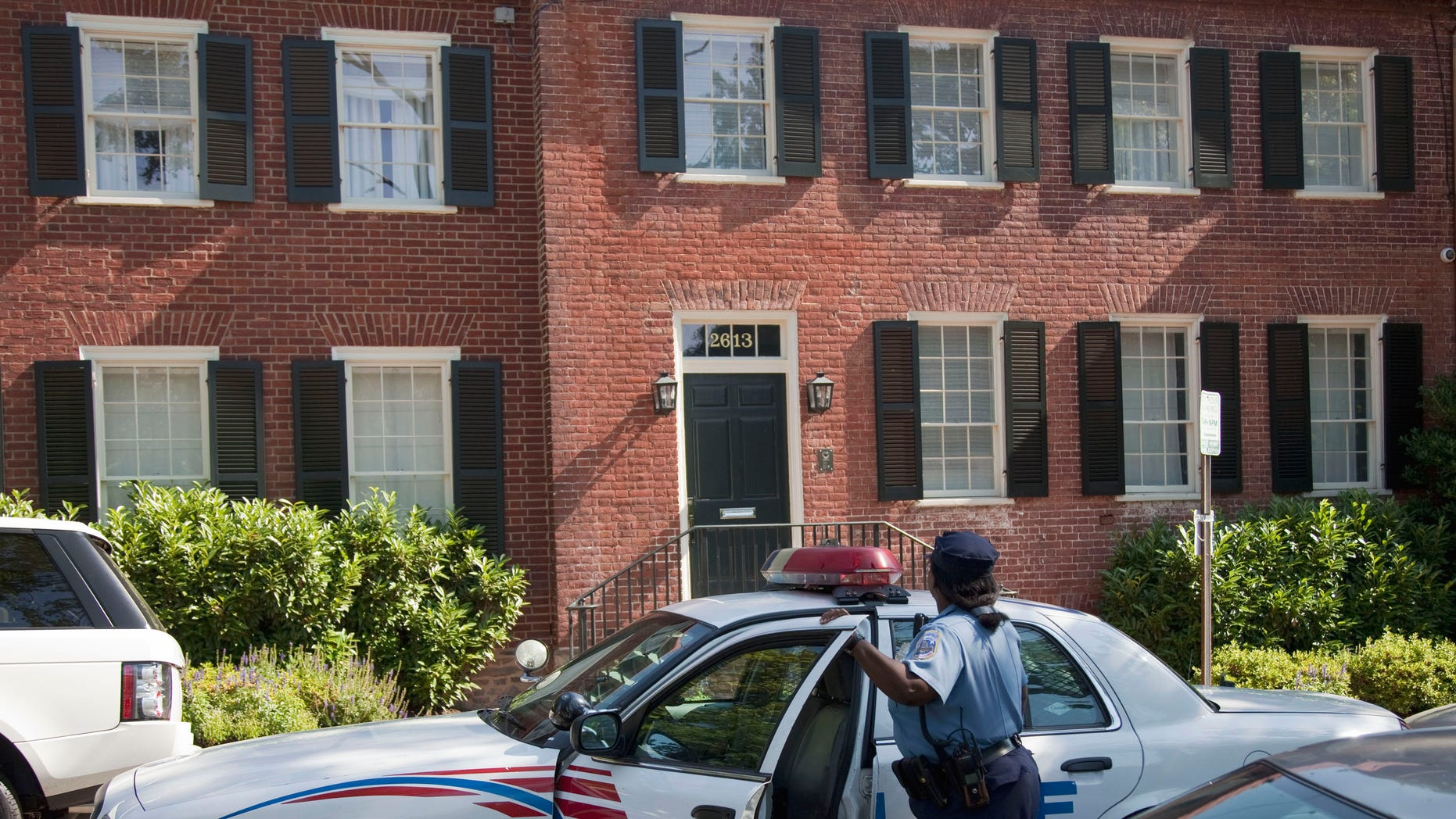 A Washington police officer arrives at the home of former IMF Managing Director Dominique Strauss-Kahn, Thursday, June 2, 2011, in Washington. An alarm company concerned about an open door called police to the home, but an official says there are no signs of a burglary.