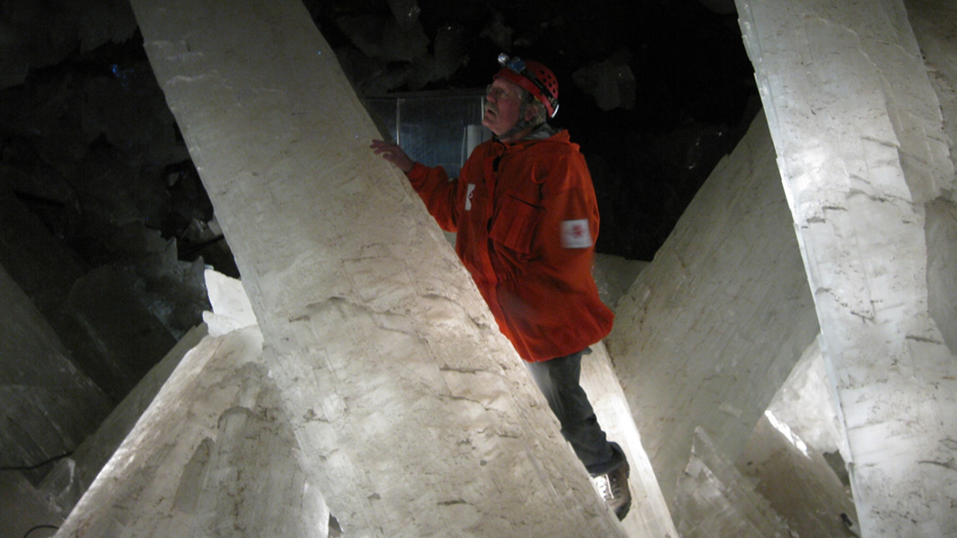 Mike Spilde, a professor at the University of New Mexico, gazes at giant selenite crystals in a chamber in the Naica Mine.