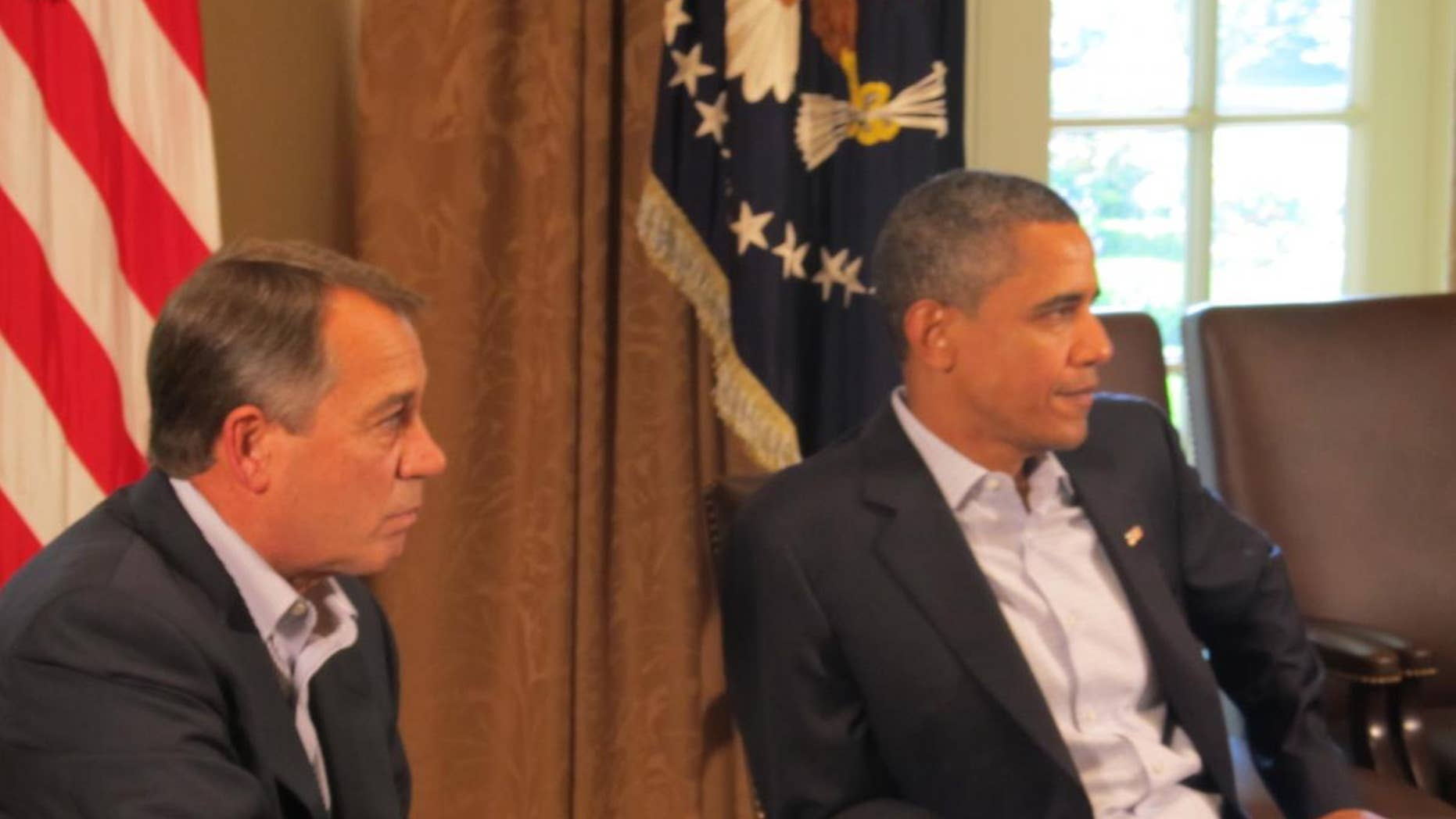 House Speaker John Boehner and President Obama Saturday, July 23, 2011 in the Cabinet Room at the White House/Travel Pool photo.