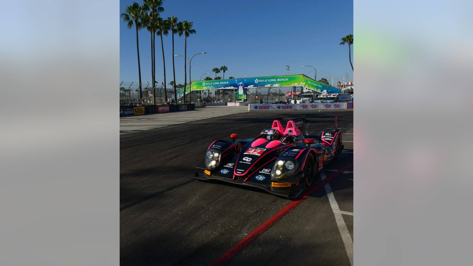 Team Oak Racing races during the practice for the IMSA series Toyota Grand Prix of Long Beach auto race in Long Beach, Calif., Friday, April 11, 2014. (AP Photo/Kelvin Kuo)