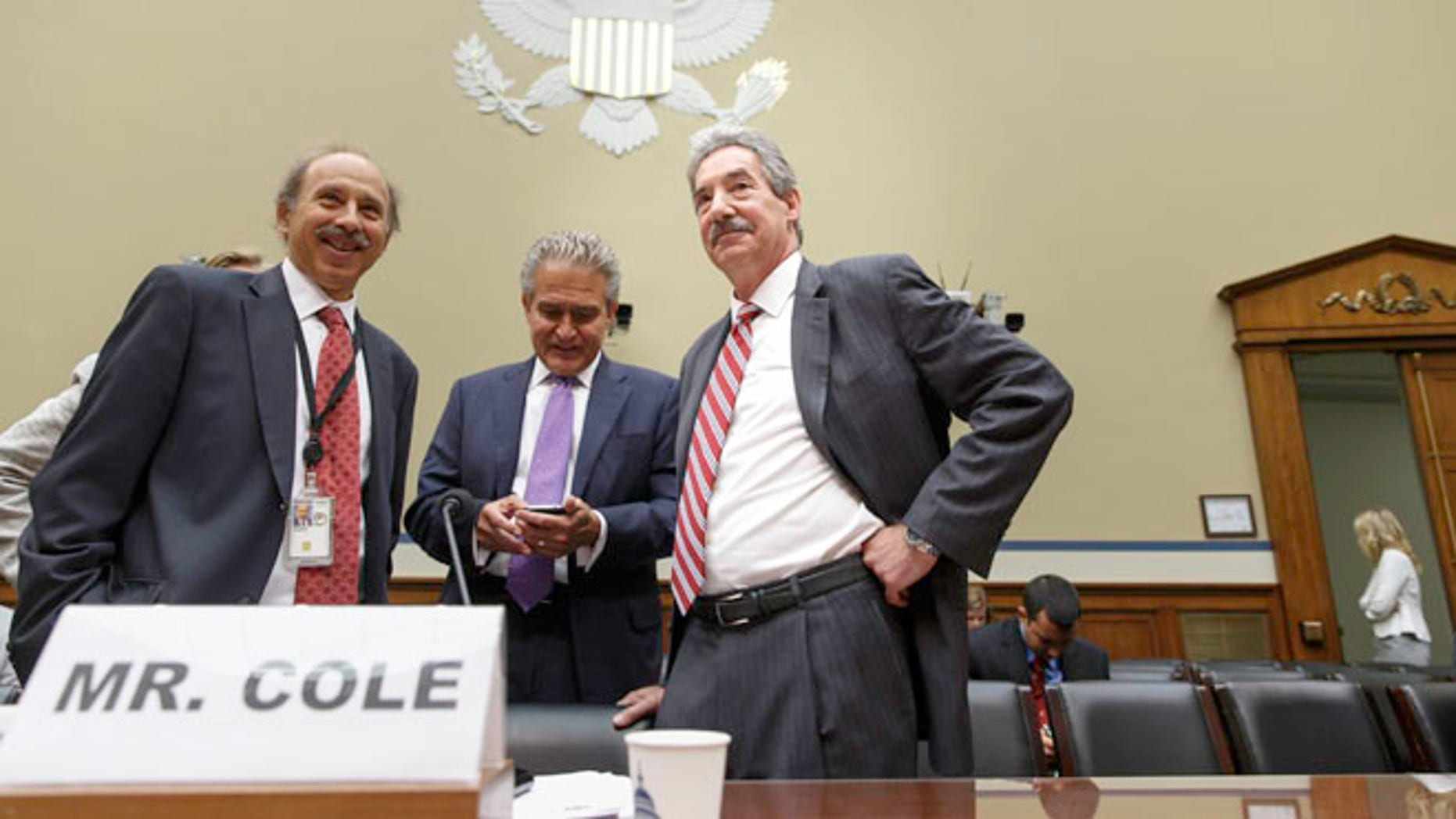 Deputy Attorney General James Cole, right, arrives on Capitol Hill in Washington, Thursday, July 17, 2014, to testify before the House  Economic Growth, Job Creation, and Regulatory Affairs subcommittee hearing on how the Justice Department is investigating allegations that the Internal Revenue Service (IRS) targeted conservative political groups for extra scrutiny.