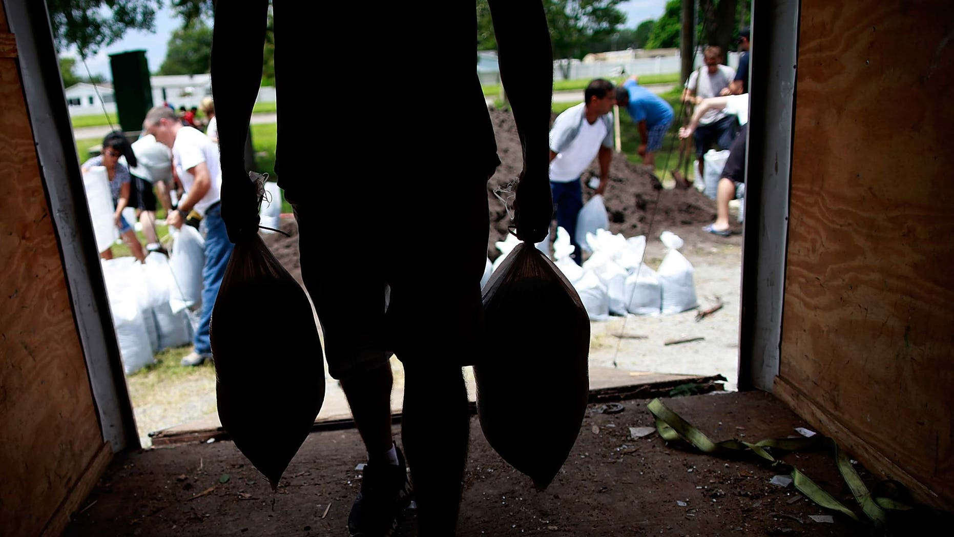 TAMPA, FL - AUGUST 25:  Tampa area residents make preparations for the arrival of Tropical Storm Issac by filling sandbags at a Hillsborough County Public Works Service Center on August 25, 2012 in Tampa, Florida. Tampa area residents wait for Tropical Storm Isaac as they prepare for the Repulican National Convention which will be held in Tampa during the week of August 27th.  (Photo by Tom Pennington/Getty Images)