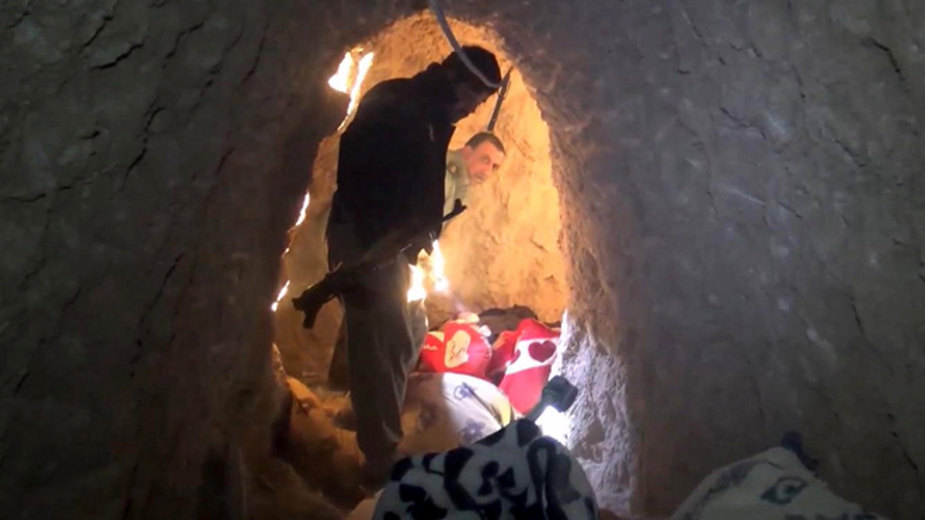 Nov. 22, 2015: Kurdish security forces are seen in a tunnel complex under the city of Sinjar, northern Iraq that were used by Islamic State fighters to move undetected and avoid coalition airstrikes before the town was retaken from the militants.