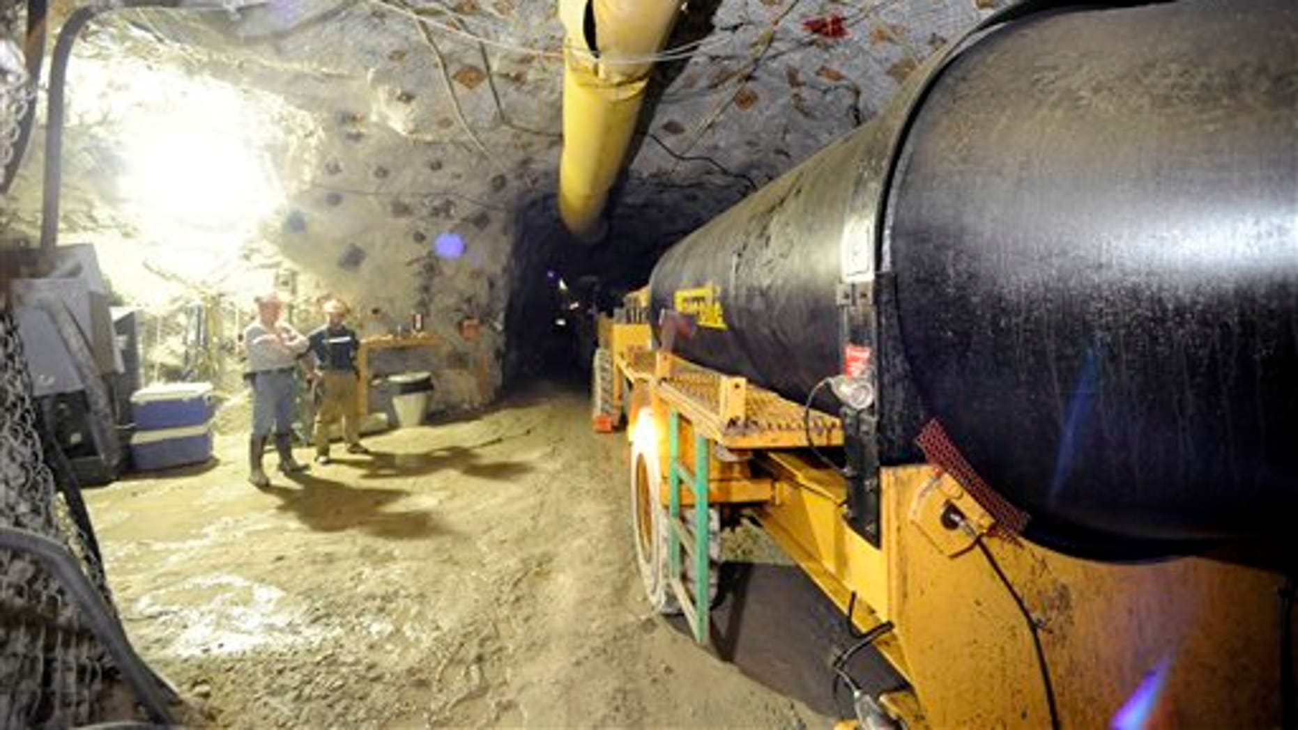 In this Nov. 24, 2010 photo, two mine workers stand inside the Lucky Friday mine in Mullan, Idaho. The roof of the tunnel collapsed on Friday, April 15, 2011, trapping Larry Marek.  Officials have not had contact with him and don't know his condition.(AP/The Spokesman-Review)