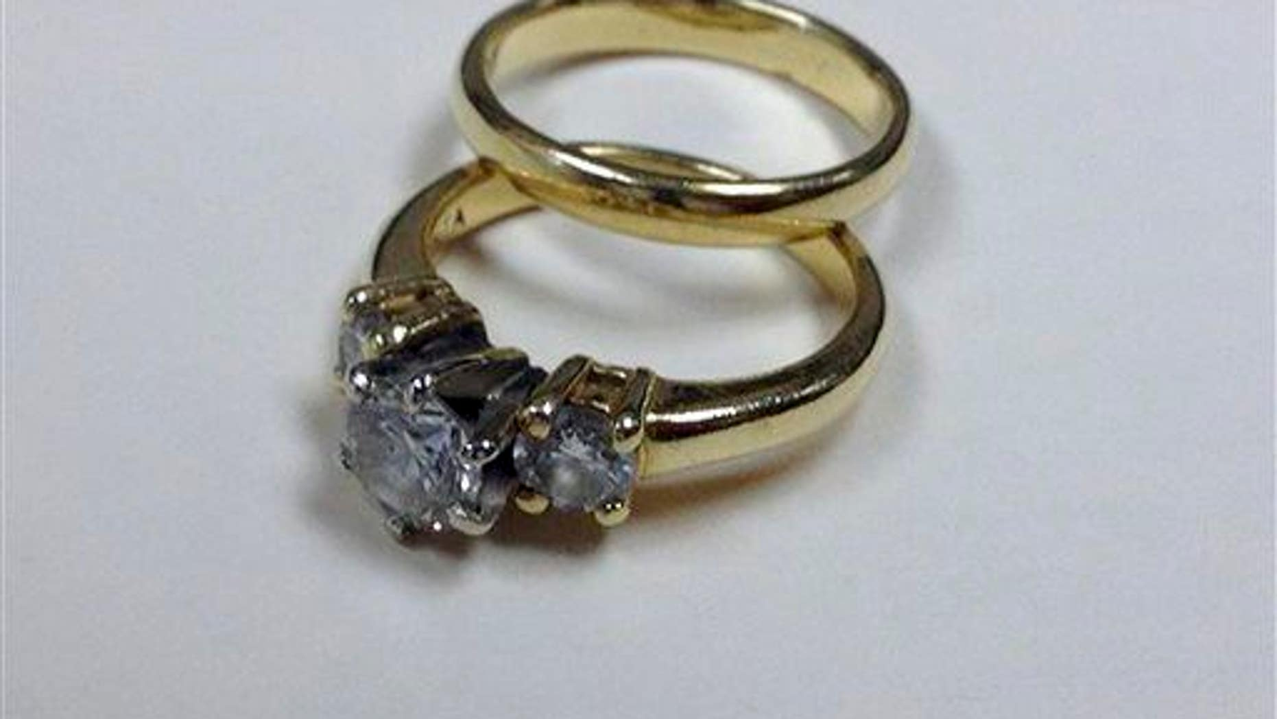 Wedding rings are shown.