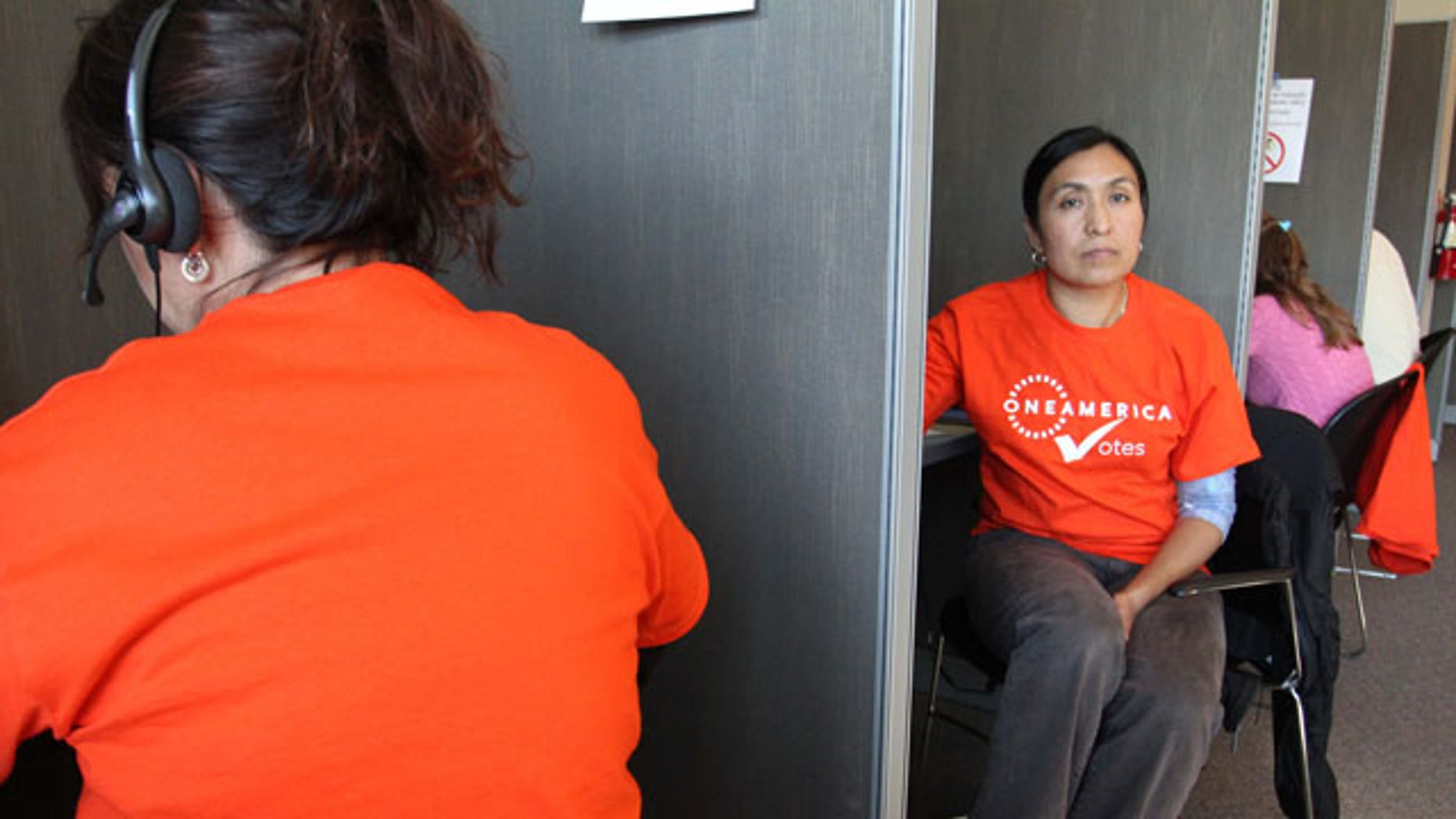 Oct. 16: Maria Gianni, an illegal immigrant, volunteers with OneAmerica Votes at a phone bank in Seattle. The organization has launched a vote drive targeting naturalized citizen voters.