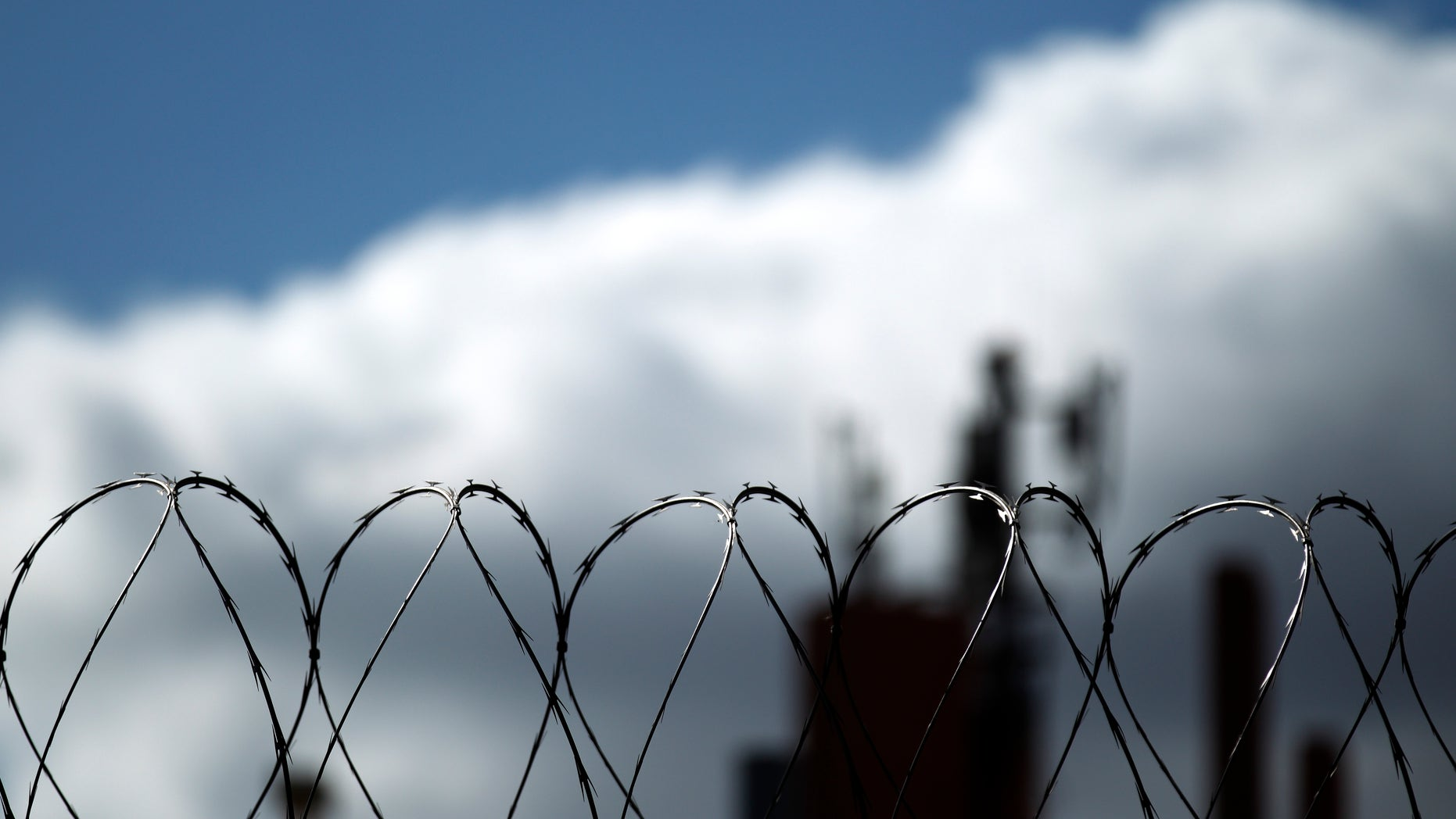 In this Monday, Jan. 31, 2011 photo, razor wire sits atop a border fence as a building in the Mexican border city of Tijuana sits behind, as seen from San Diego. After a dropoff during the recession, illegal immigrants seeking to sneak across the U.S. border may be ready to move again, according to a new study released Tuesday. (AP Photo/Gregory Bull)
