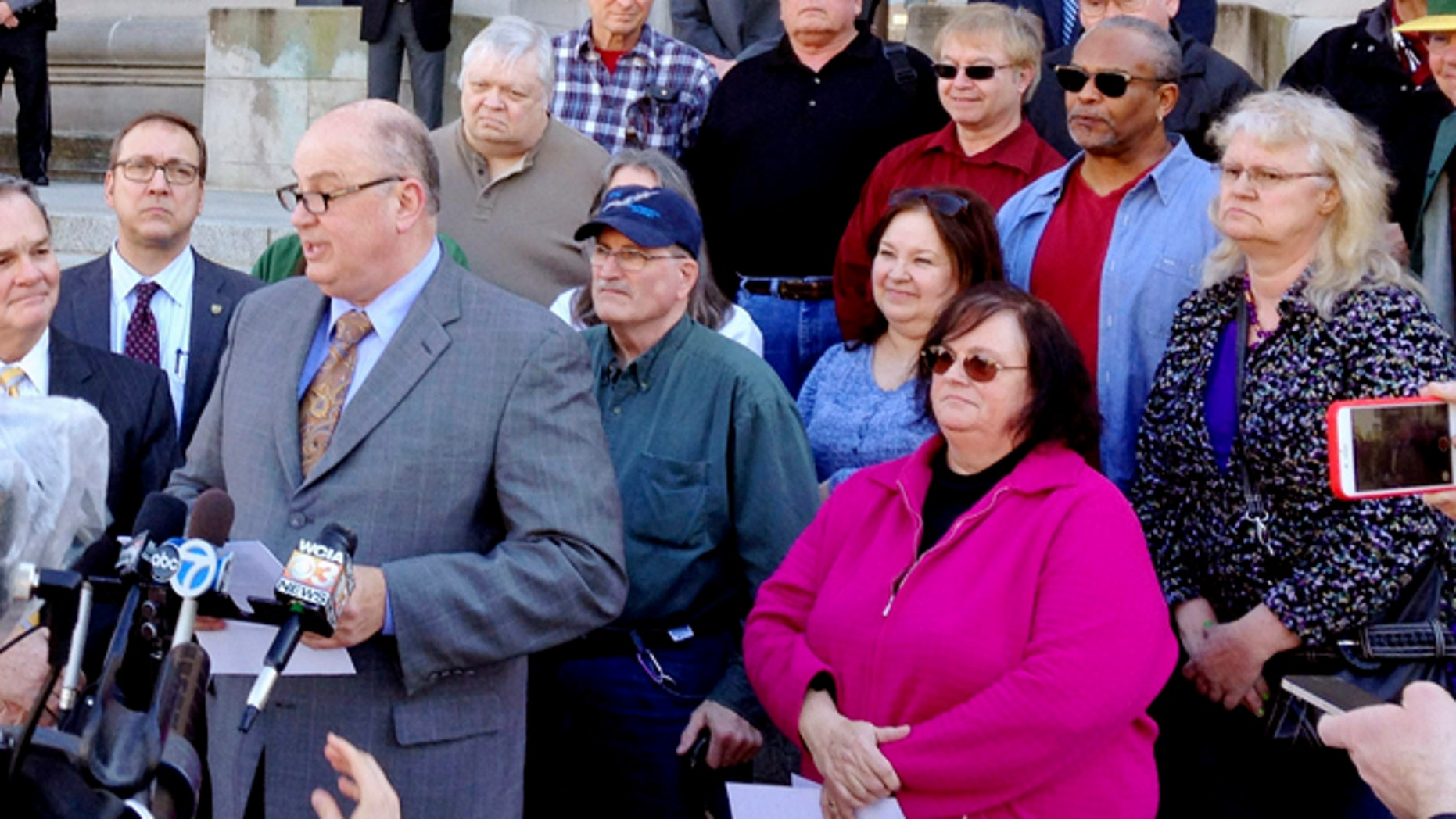 March 11, 2015: Illinois AFL-CIO President Michael Carrigan is joined by state workers and retirees outside the Illinois Supreme Court in Springfield, Ill., as he addresses the media following oral arguments in a lawsuit over a state pension overhaul.