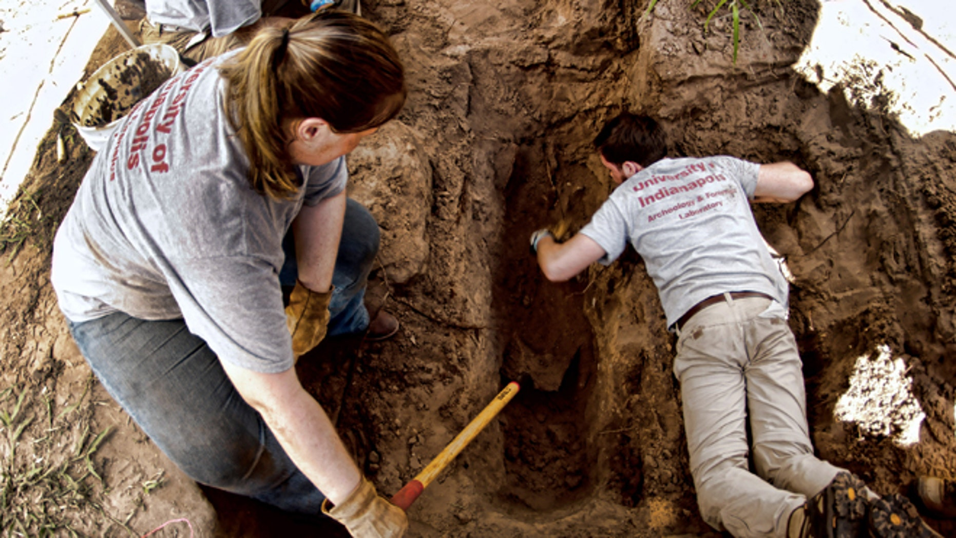 June 5, 2014: University of Indianapolis students use shovels and hand tools for delicate forensic archeology work at the Sacred Heart Burial Park in Falfurrias,Texas, where the graves of unidentified immigrants have been found.