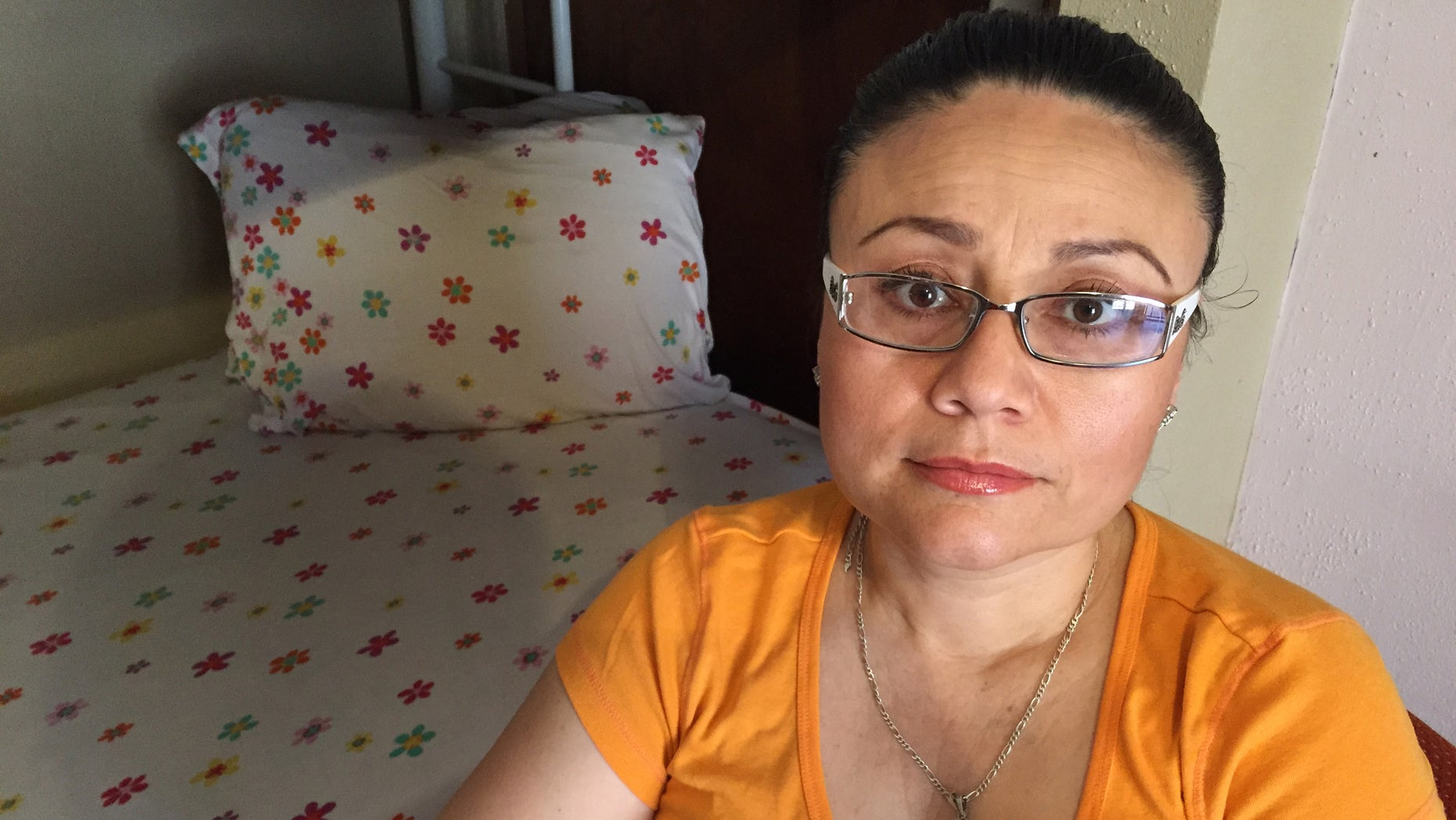 In this Thursday, July 30, 2015 photo, Rosa Robles Loreto sits in her small room at Southside Presbyterian Church in Tucson, Ariz., where she has taken sanctuary from deportation for a year. Robles Loreto, 42, says she is not leaving the church until the government assures her she will not be deported. (AP Photo/Astrid Galvan,File)