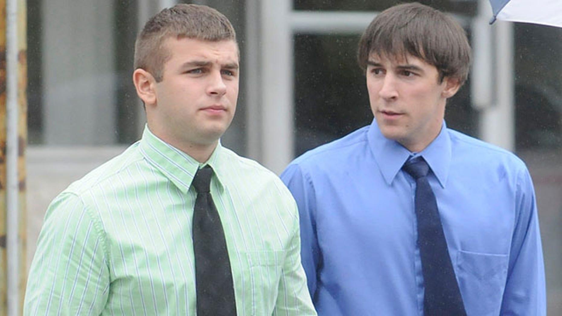 Oct. 4, 2010: Brandon J. Piekarsky, 18, of Shenandoah Heights, left, and Derrick M. Donchak, 20, of Shenandoah, return to the William J. Nealon Federal Building and United States Courthouse in Scranton, Pa.