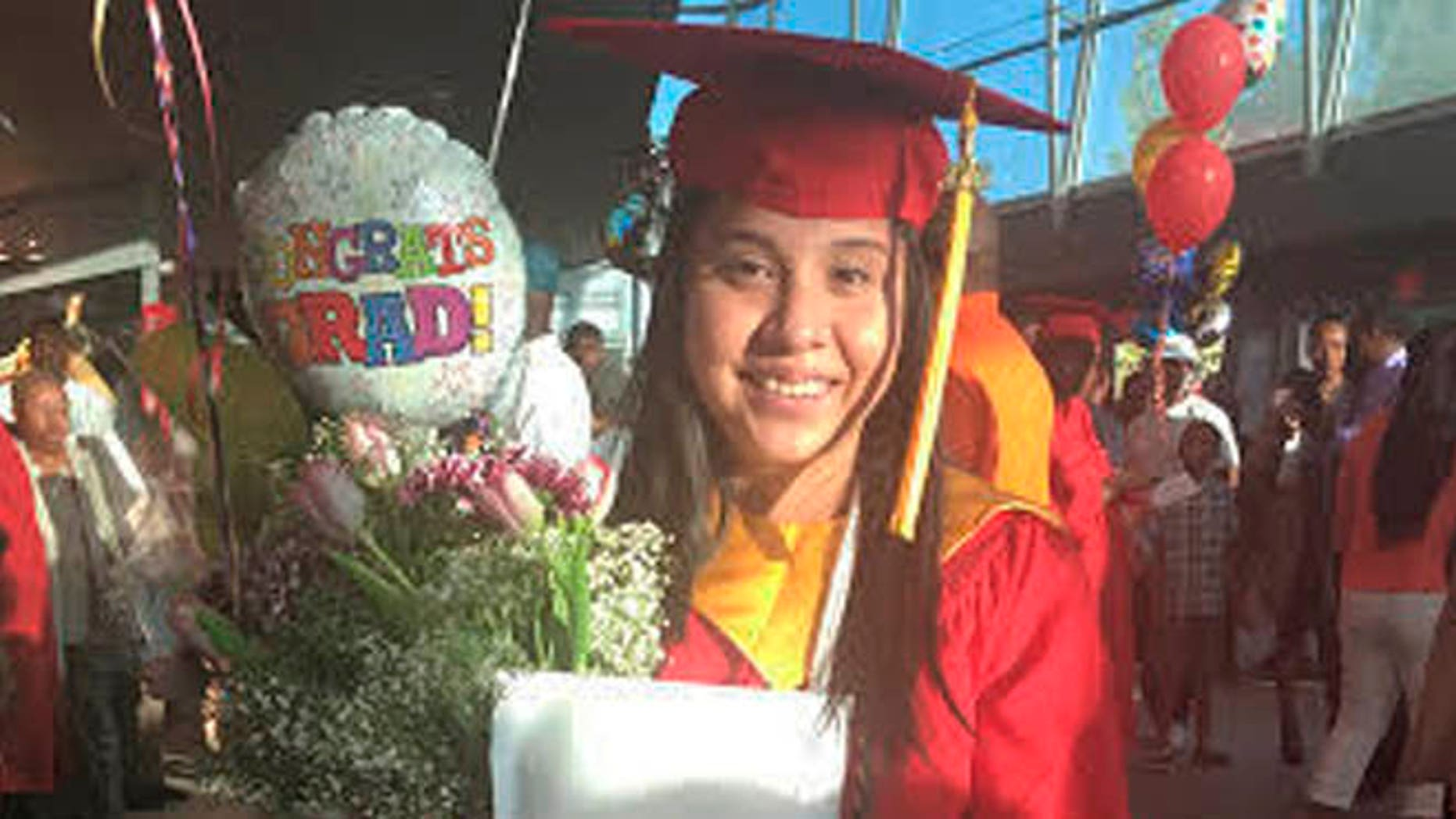 In this May 21, 2016 photo provided by Jessica Barcenas, Ivonne Barcenas Garcia poses in her cap and gown after her high school graduation held at the University of Georgia's Stegeman Coliseum in Athens, Ga. Growing up in Athens, Ivonne Barcenas, 18, had hopes of attending the University of Georgia. But a state law prohibits immigrants without permanent legal status from attending top public universities. Barcenas, whose family came from Mexico when she was 3, is among dozens of students awarded a private scholarship to attend Eastern Connecticut State University in the fall. The scholarship program helps immigrants from states with policies like Georgia's to attend and pay for college. (Jessica Barcenas via AP)