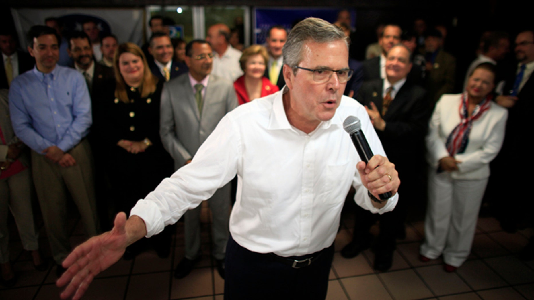 Jeb Bush speaks at a town hall meeting April 28, 2015. Hillary Rodham Clinton's challenge to the GOP on immigration is an early counter to Jeb Bush and other Republican White House contenders seeking Hispanic voters. Among them are GOP lawmakers who once opposed an immigration overhaul in Congress but now say they may be willing to allow millions living in the country illegally to stay. (AP Photo/Ricardo Arduengo)