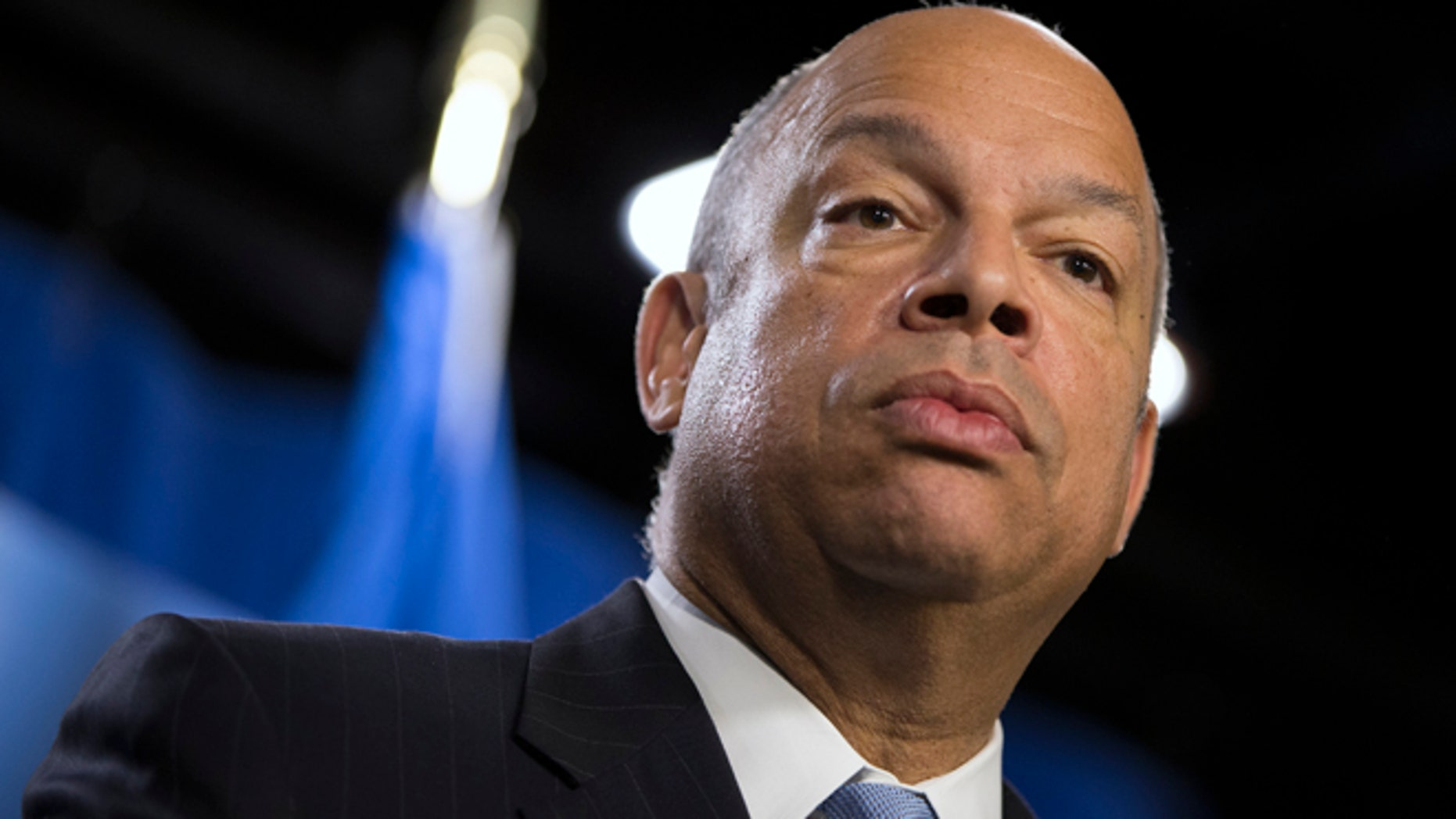 FILE - In this March 18, 2014, file photo, Department of Homeland Security Secretary Jeh Johnson speaks during a news conference in Washington. Johnson, who's conducting a politically charged review of the nation's deportation policy, said Thursday, May 15 he's looking at making changes to a much-criticized program that runs people booked for local crimes through a federal immigration database.(AP Photo/ Evan Vucci, File)