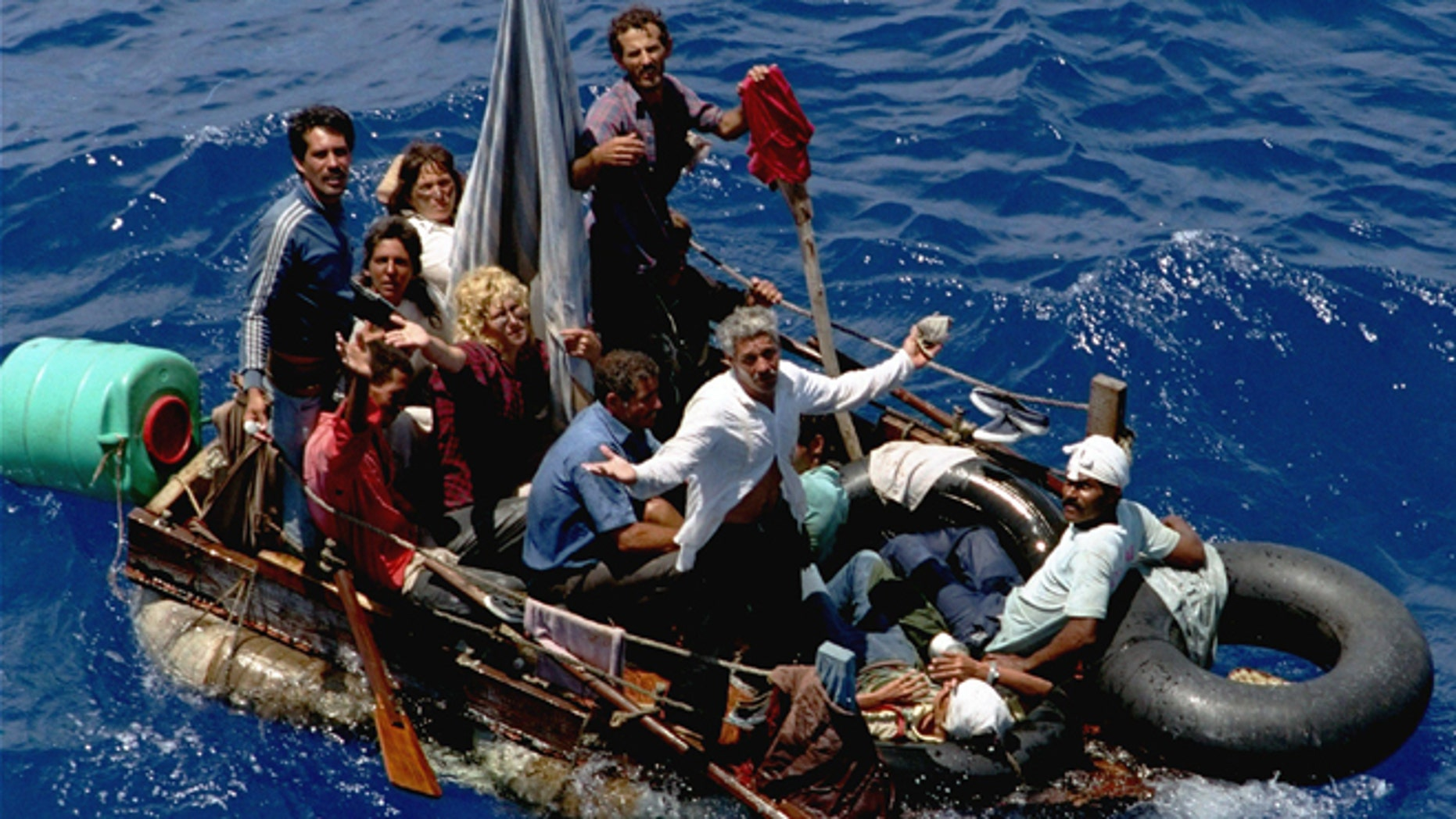 FILE - In this Aug. 24, 1994 file photo, Cuban refugees stranded on a makeshift raft float in the open sea about halfway between Key West, Fla., and Cuba. While more than 50 years of enmity between the United States and Cuba is slowly vanishing, the renewed relationship is sparking fears on the communist island nation that the U.S. could also erase a unique immigration policy that favors Cubans. (AP Photo/Hans Deryk, File)