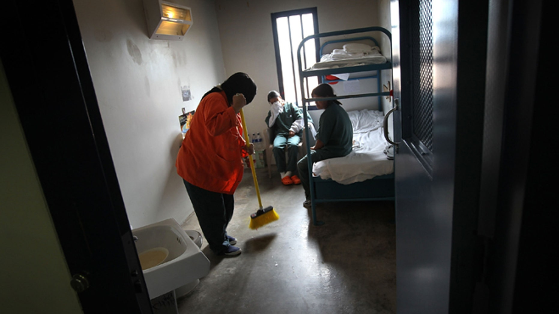 ELOY, AZ - JULY 30:  A female detainee cleans a housing cell in a women's wing at an detention facility for illegal immigrants on July 30, 2010 in Eloy, Arizona. Most immigrants at the center are awaiting deportation or removal and return to their home countries, while some are interned at the facility while their immigration cases are being reviewed. The U.S. Immigration and Customs Enforcement (ICE), in Arizona holds almost 3,000 immigrants statewide, all at the detention facilities in  Eloy and nearby Florence. Arizona, which deports and returns more illegal immigrants than any other state, is currently appealing a judge's ruling suspending controversial provisions of Arizona's immigration enforcement law SB 1070.  (Photo by John Moore/Getty Images)