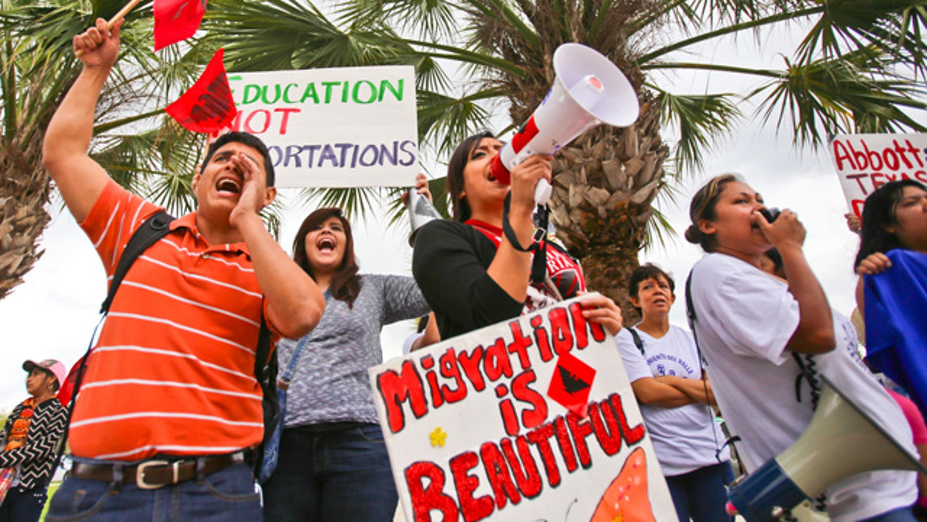March 19, 2015: Over a hundred protesters stand outside of the federal courthouse in Brownsville, Texas to protest a federal judge's hold on President Obama's executive action on immigration. (AP Photo/The Brownsville Herald, Yvette Vela)