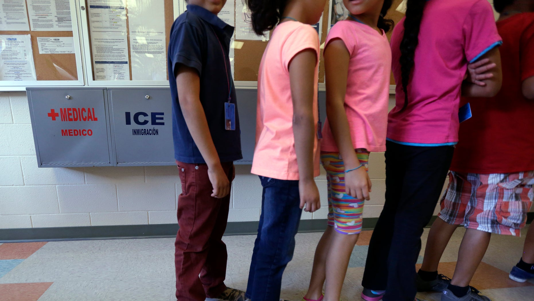 Detained immigrant children line up in a cafeteria at a temporary home in Karnes City, Texas.