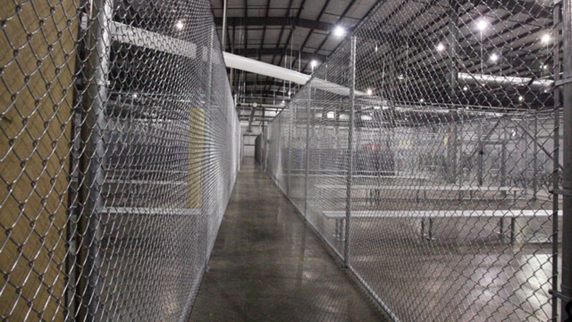 July 17, 2014: This photo shows a new intake facility built to help alleviate overcrowding at the U.S. Customs and Border Protection's McAllen Station in McAllen, Texas. (AP Photo/The McAllen Monitor, Joel Martinez)