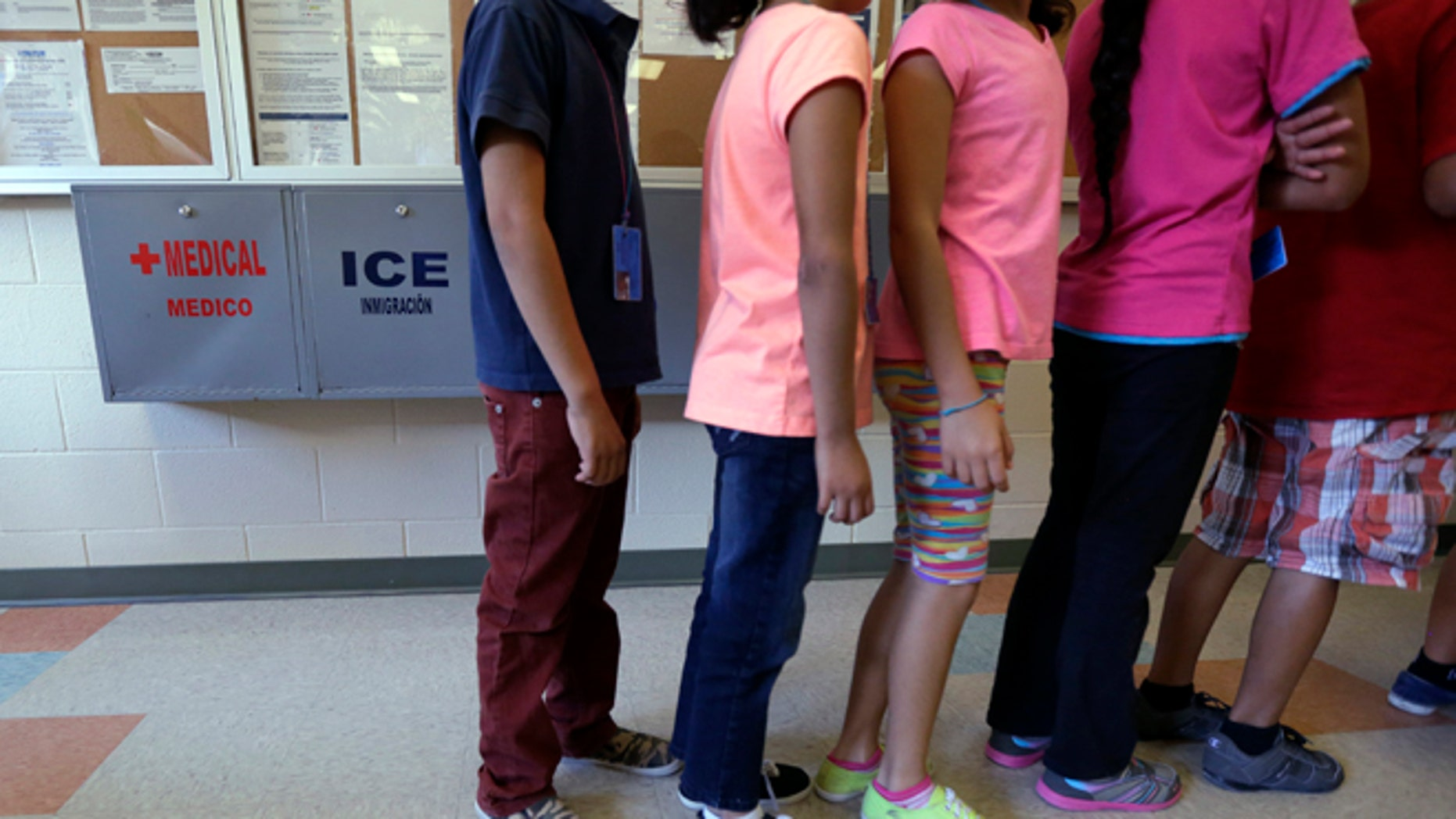 FILE - In this Sept. 10, 2014 file photo, detained immigrant children line up in the cafeteria at the Karnes County Residential Center in Karnes City, Texas. Karnes, one of the nation's largest detention centers for families caught crossing the southern U.S. border received a temporary residential child-care license from the Texas Department of Family and Protective Services. DFPS spokesman Patrick Crimmins said Tuesday May 3, 2016, the agency granted the six-month license last week to the facility. (AP Photo/Eric Gay, File)