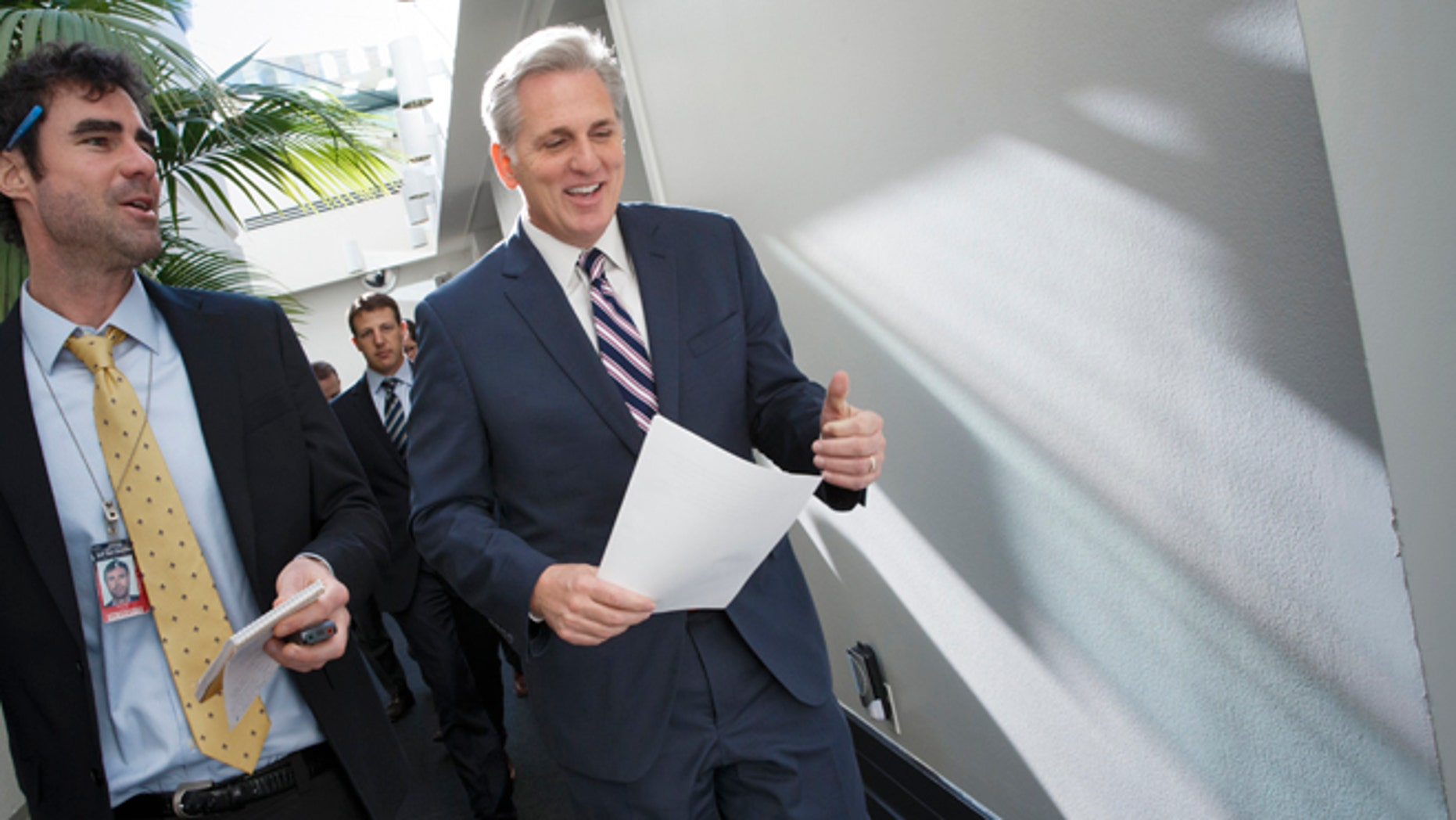 House Majority Leader Kevin McCarthy of Calif., center, walks with a reporters as on Capitol Hill in Washington, Friday, Jan. 9, 2015, as House Republicans leave a closed-door meeting on thwarting President Barack Obama's executive actions on immigration by blocking the funding for the Department of Homeland Security, Obama's directives in November gave temporary relief from deportation to about 4 million immigrants in the country illegally, along with permits allowing them to work legally in the U.S. His move infuriated Republicans after their midterm election victories, and they vowed to retaliate once they assumed full control of Congress this week. (AP Photo/J. Scott Applewhite)