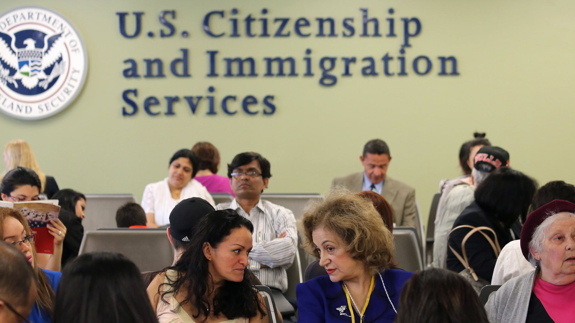 NEW YORK, NY - MAY 30:  Immigrants await their turn for green card and citizenship interviews at the U.S. Citizenship and Immigration Services (USCIS) Queens office on May 30, 2013 in the Long Island City neighborhood of the Queens borough of New York City. The branch office is located in an area heavily populated by immigrants and processes thousands of Green Card and U.S. citizenship applications each year.  (Photo by John Moore/Getty Images)