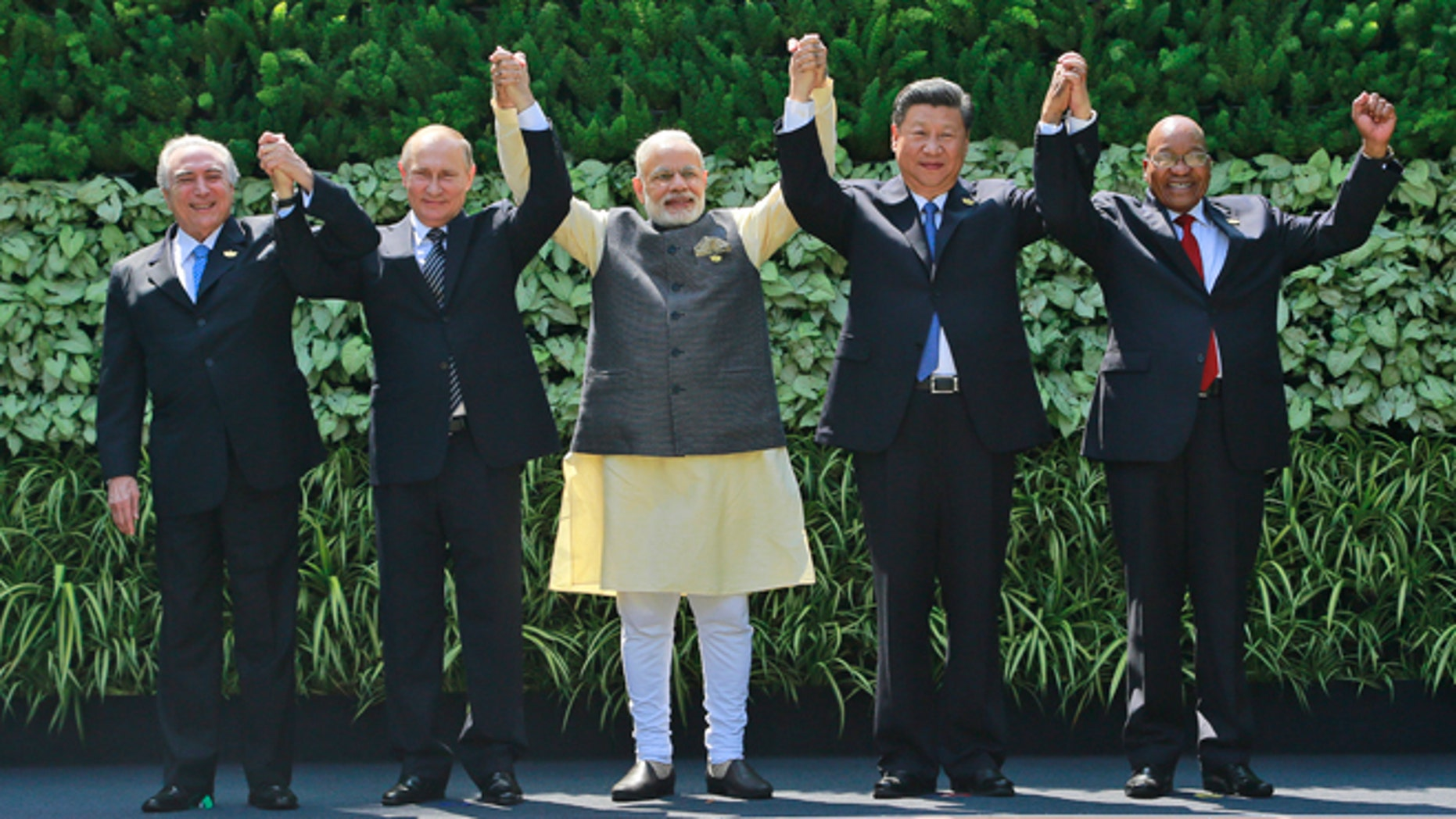 Brazilian President Michel Temer, Russian President Vladimir Putin, Indian Prime Minister Narendra Modi, Chinese President Xi Jinping, and South African President Jacob Zuma in Goa, India, Sunday, Oct. 16, 2016.