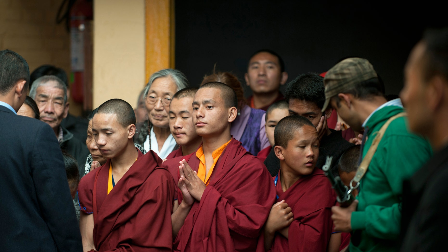 Oct. 31, 2012: Tibetan Buddhist monks wait to greet their spiritual leader the Dalai Lama, unseen, during a religious talk at the Tsuglakhang temple in Dharmsala, India.